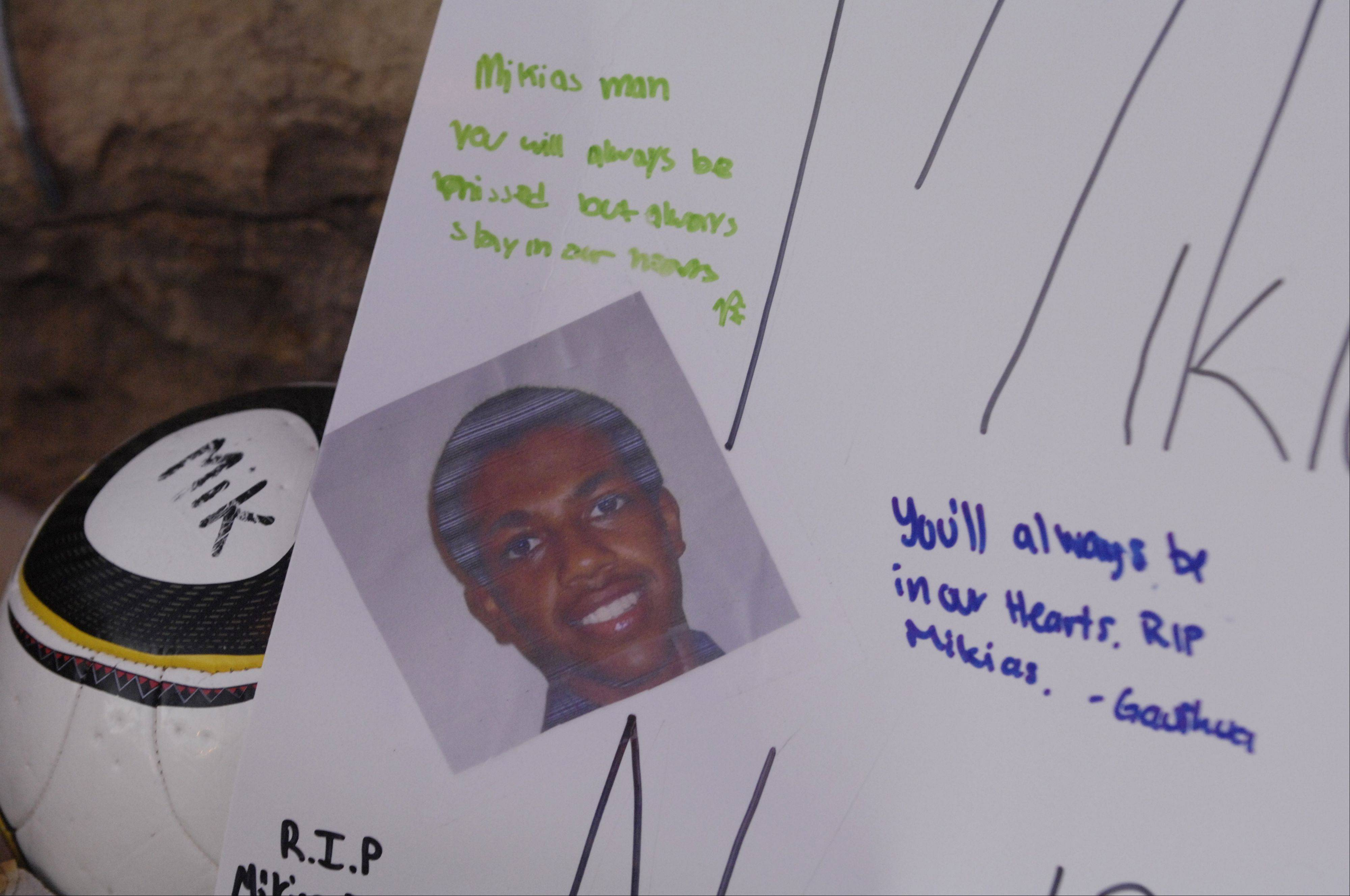 Mourners left messages on a roadside memorial in honor of Mikias Tibebu who was killed by a hit-and-run driver over the weekend in Schaumburg.