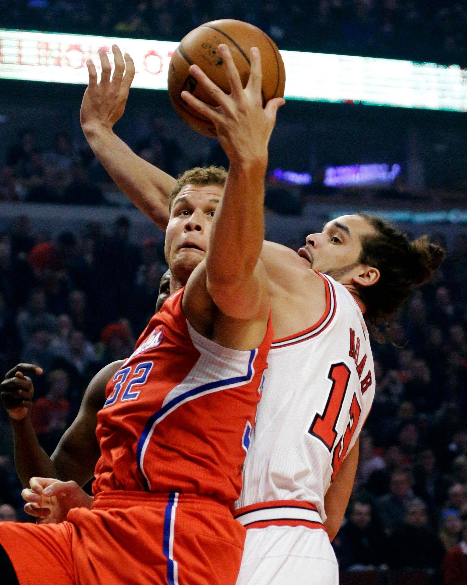 Los Angeles Clippers forward Blake Griffin grabs a rebound over Bulls center Joakim Noah Tuesday during the first half at the United Center.