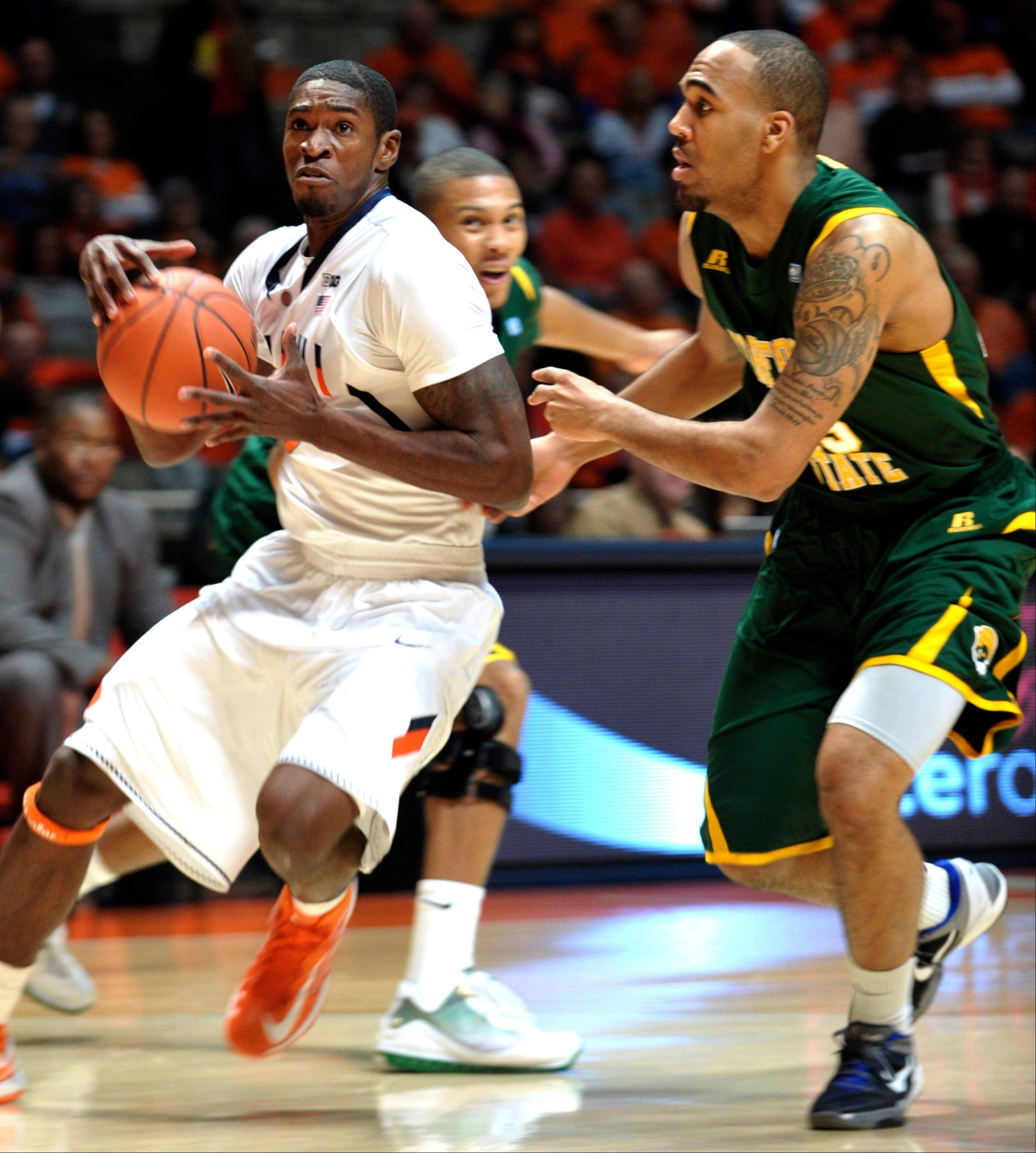 Illinois guard Brandon Paul drives around Norfolk State's Malcolm Hawkins Tuesday during the first half at Assembly Hall in Champaign.