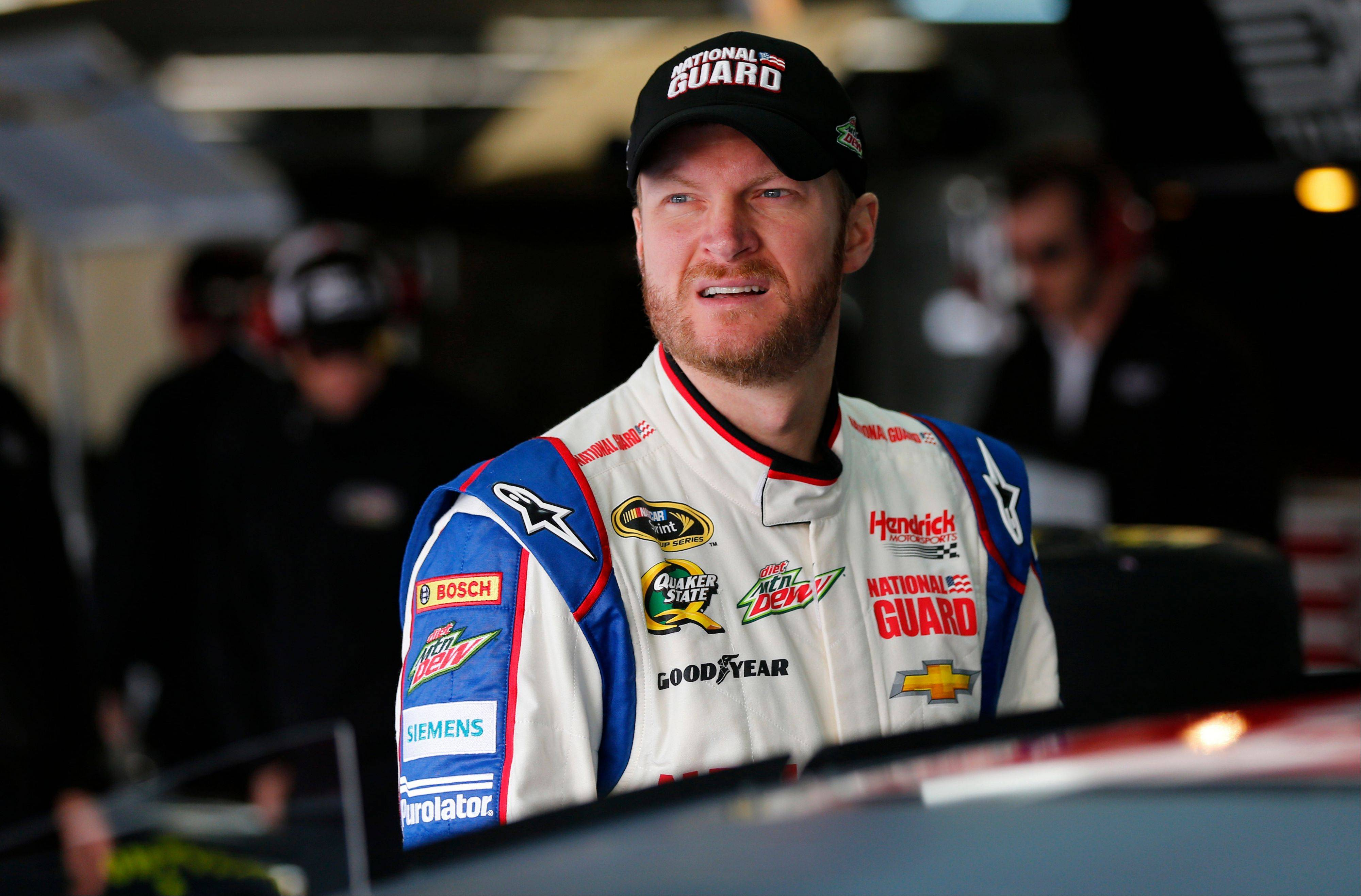 Dale Earnhardt Jr looks out of the garage area Tuesday before testing for the NASCAR Sprint Cup auto racing series at Charlotte Motor Speedway in Concord, N.C.