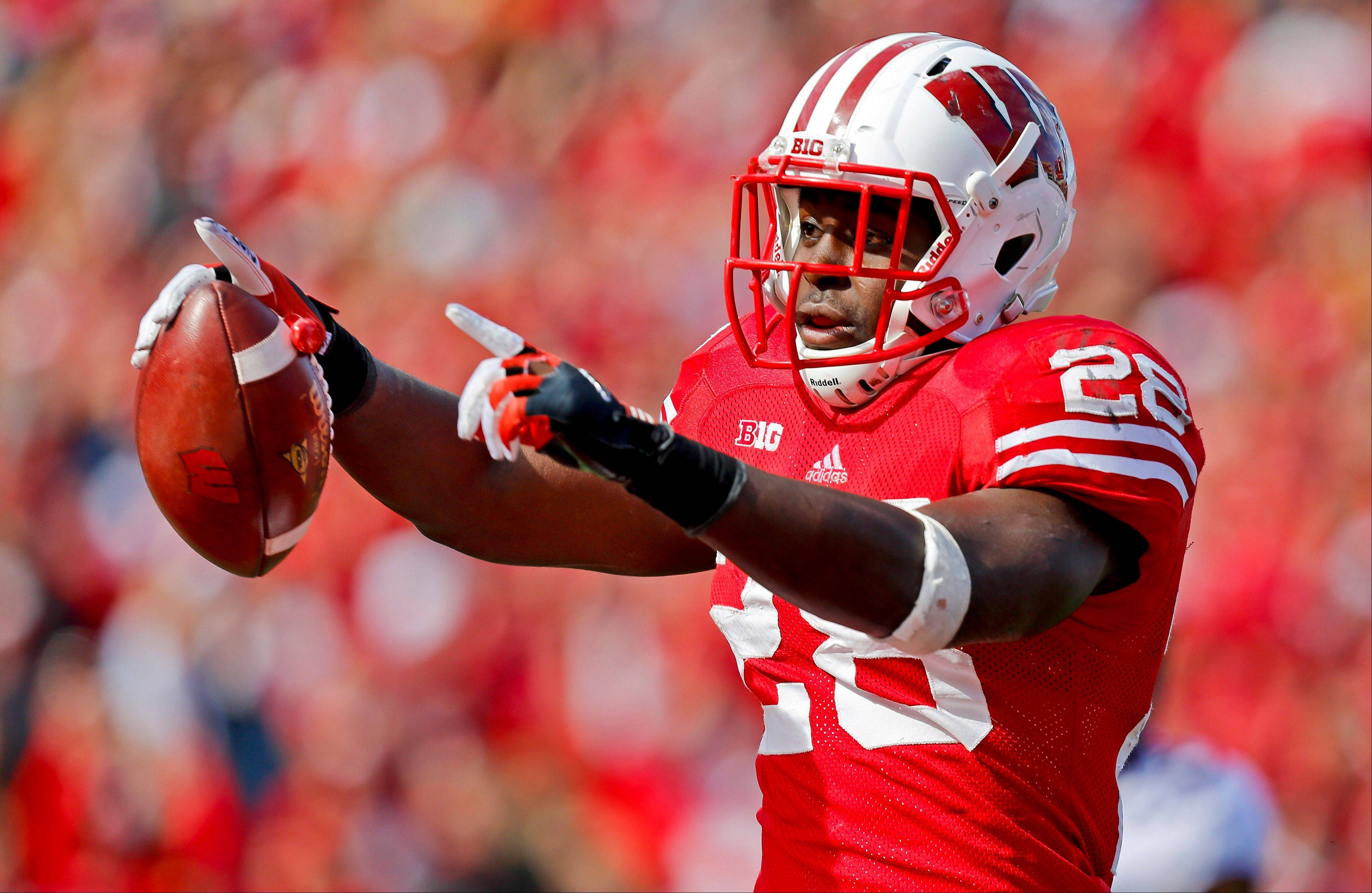 Wisconsin running back Montee Ball celebrates a touchdown against Minnesota. Ball was selected to the first-team on The Associated Press All-America football team.