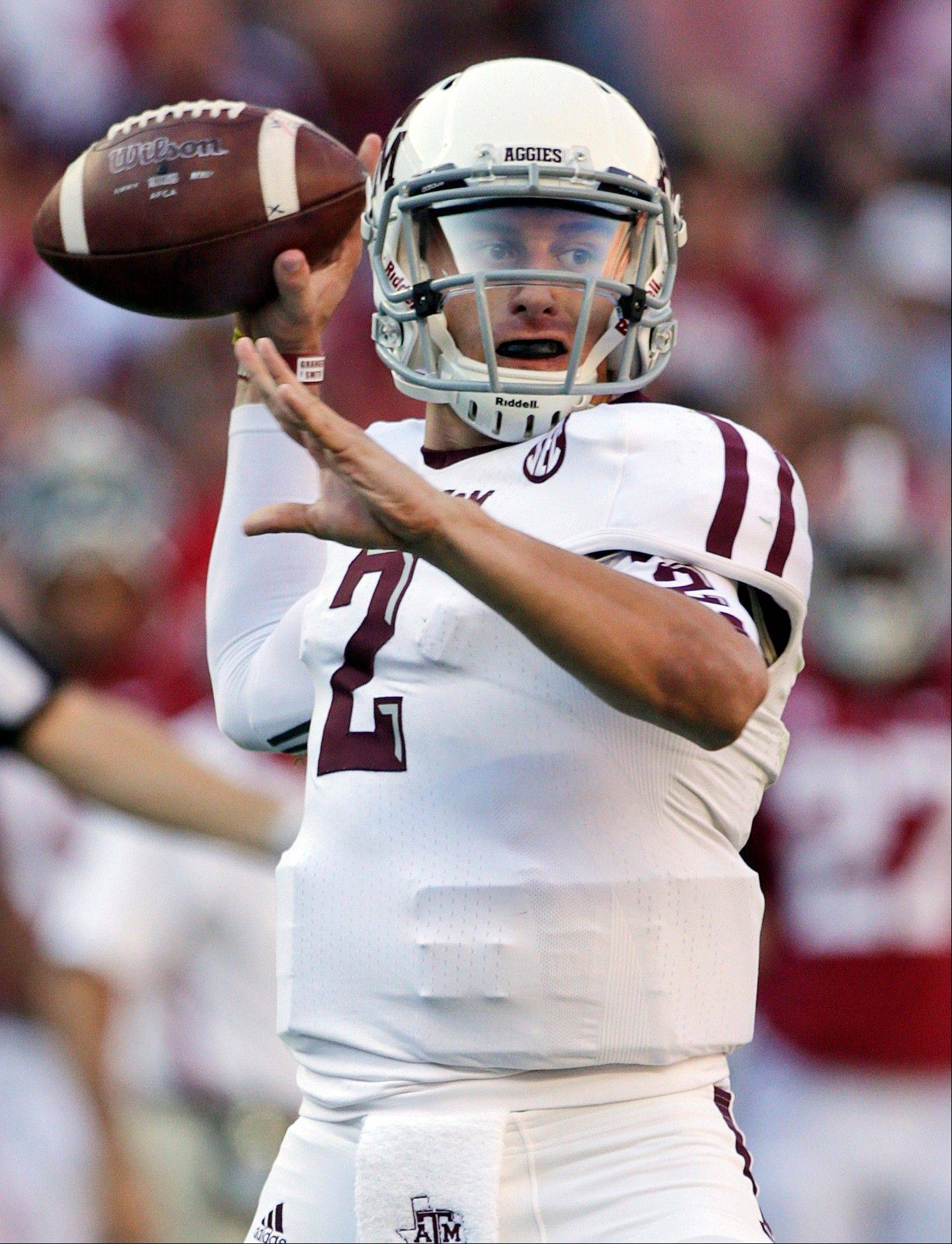 Texas A&M quarterback Johnny Manziel looks for a receiver against Alabama. Manziel was selected to the first-team on The Associated Press All-America football team.