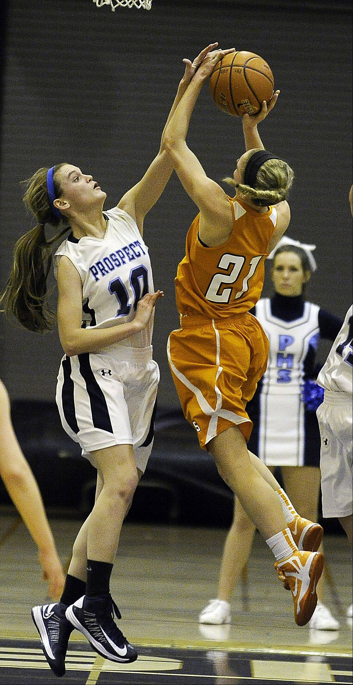 Prospect's Taylor Will blocks the shot taken by Hersey's Meg Cerniglia during Friday's game in Mount Prospect.