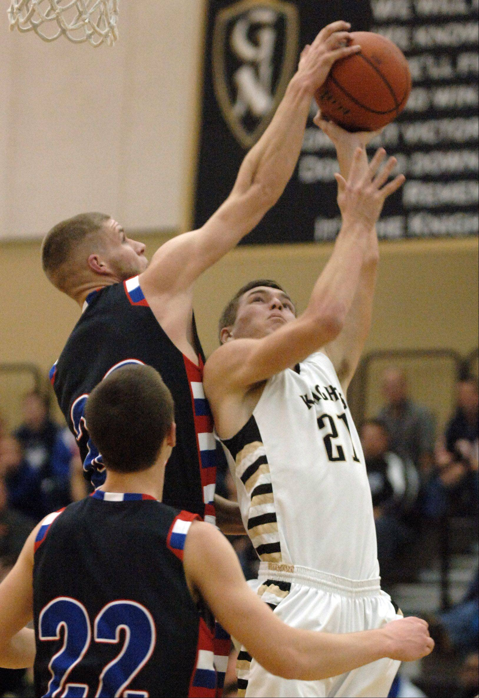 Lakes' Jake Kohler blocks the shot of Grayslake North's Ben Smith during Friday's game in Grayslake.