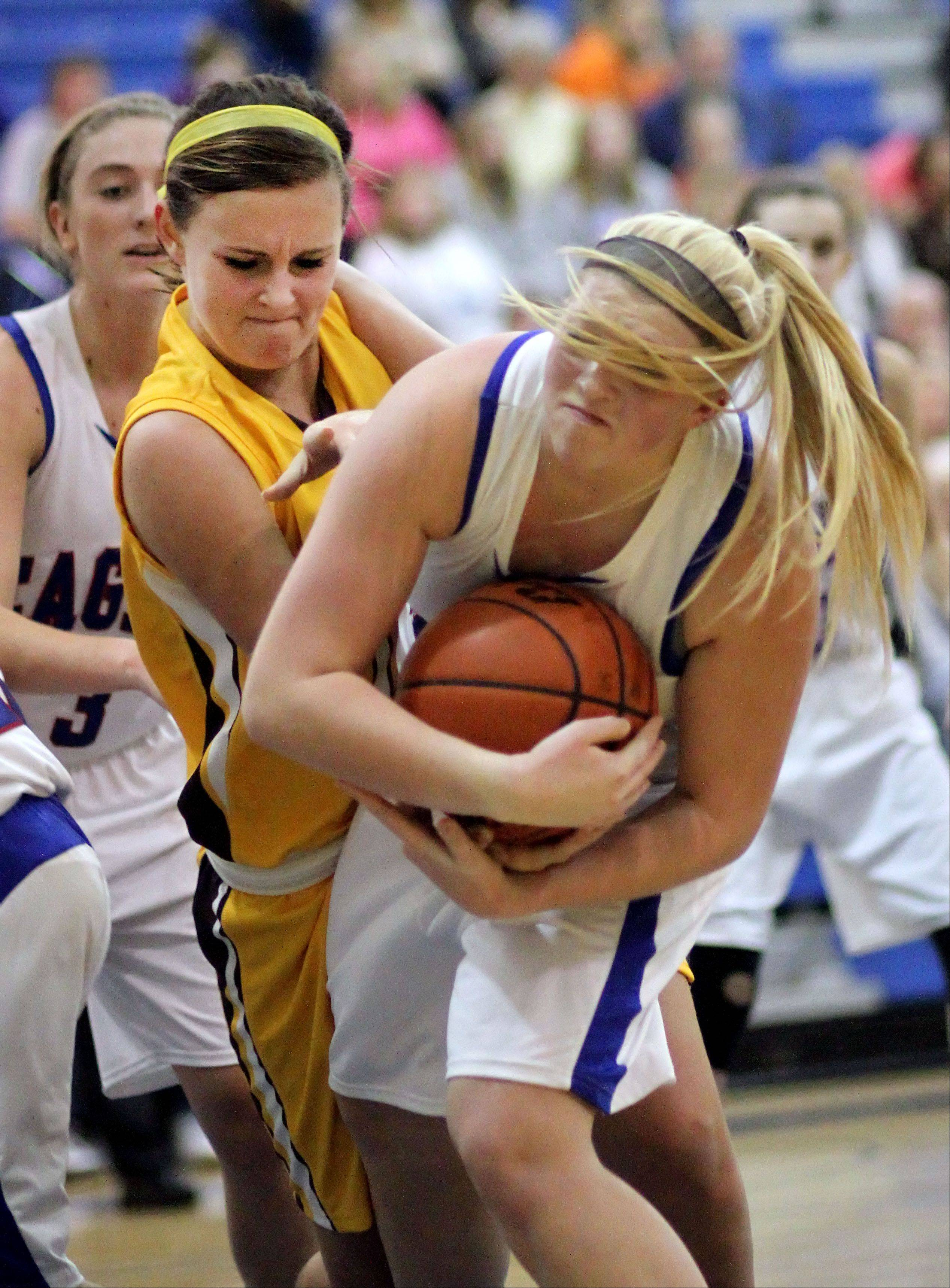 Carmel's Cassidy Kloss, left, and Lakes' Dayna Olson battle for a loose ball during their game Monday night at Lakes High School.