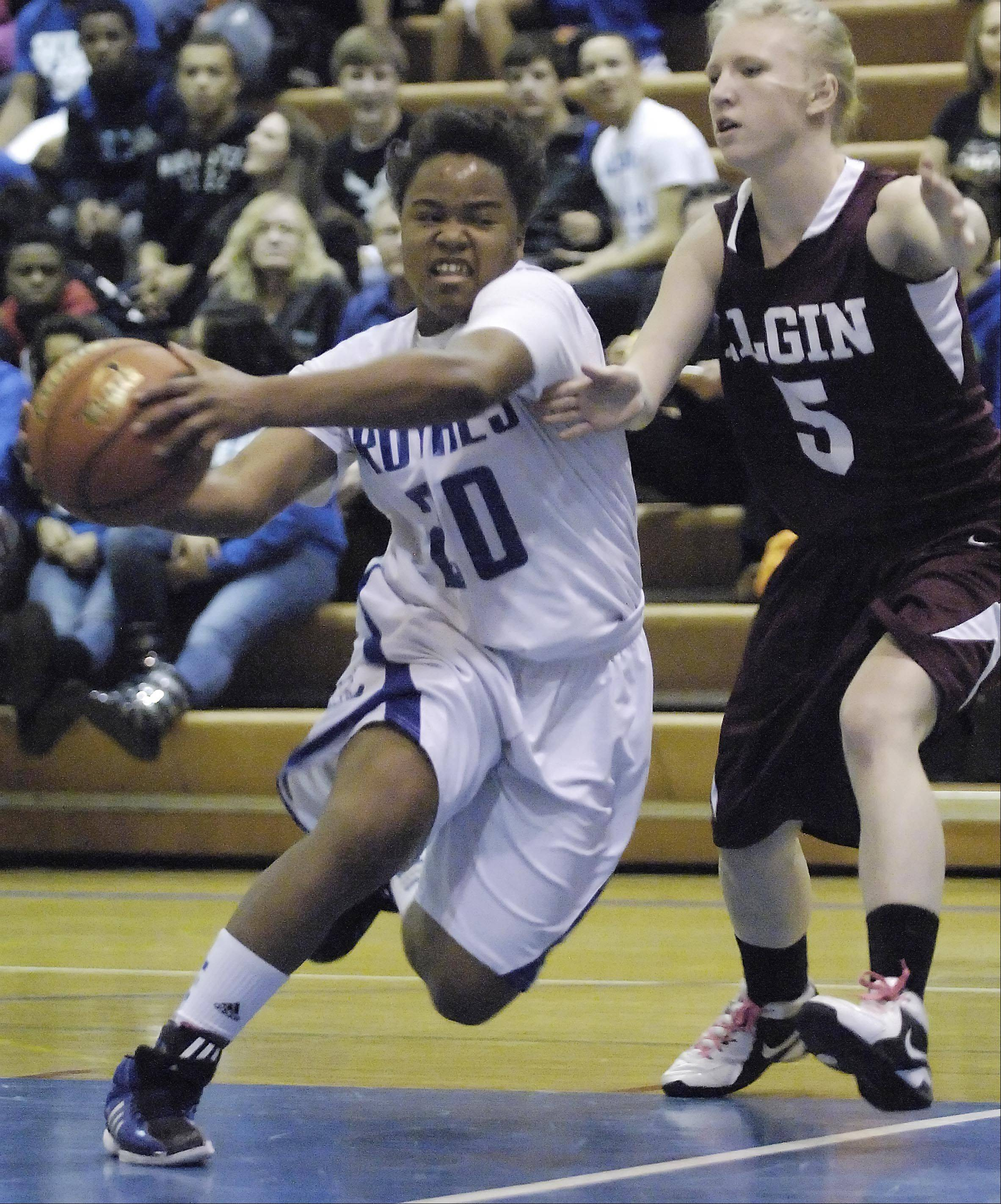Larkin's Quixmia Washington drives around Elgin's Melanie Berg Tuesday at Larkin High School.