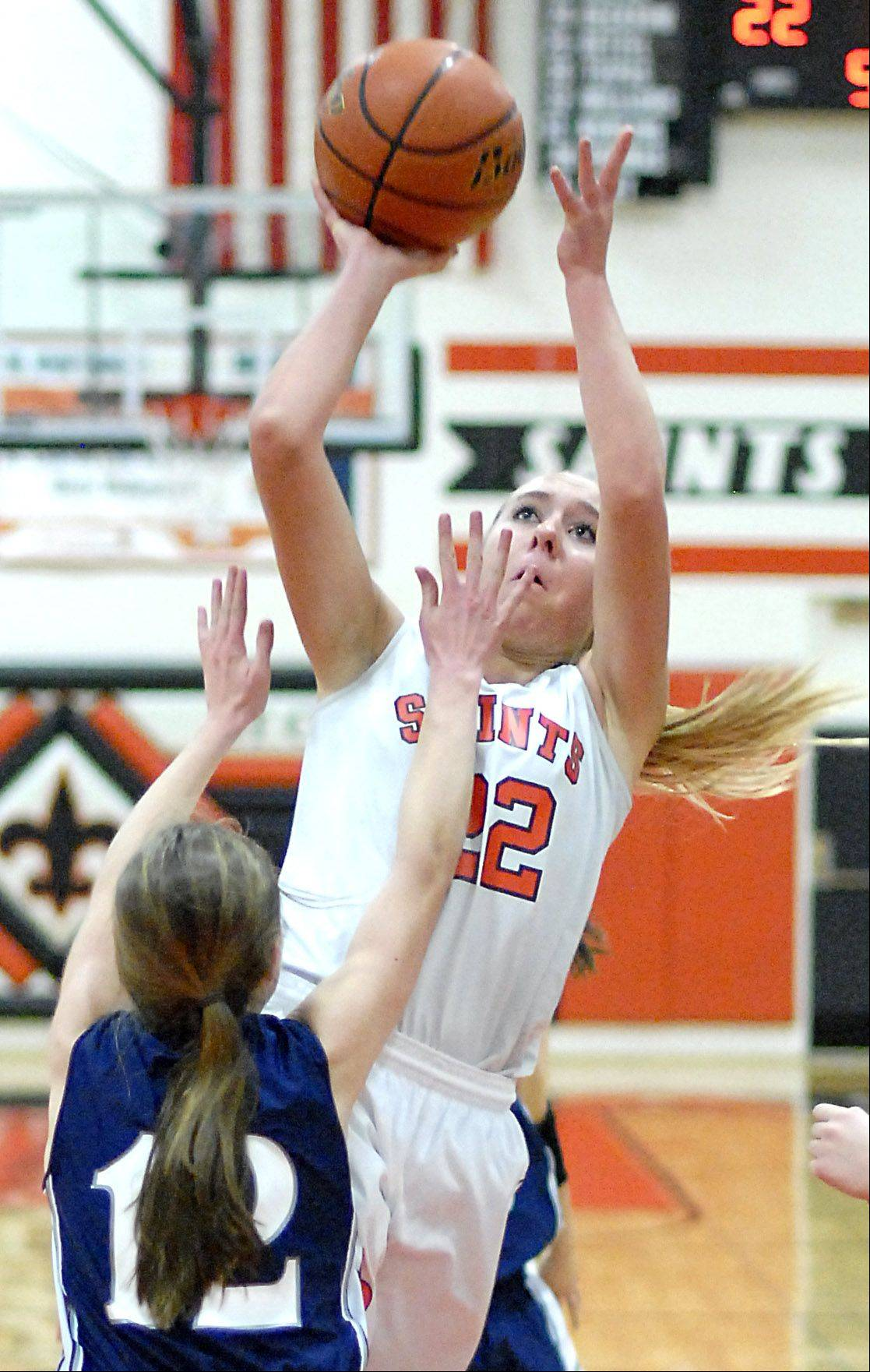 St. Charles East's Anna Bartels sinks a shot over West Chicago's Mae Elizabeth Gimre during Tuesday's game.