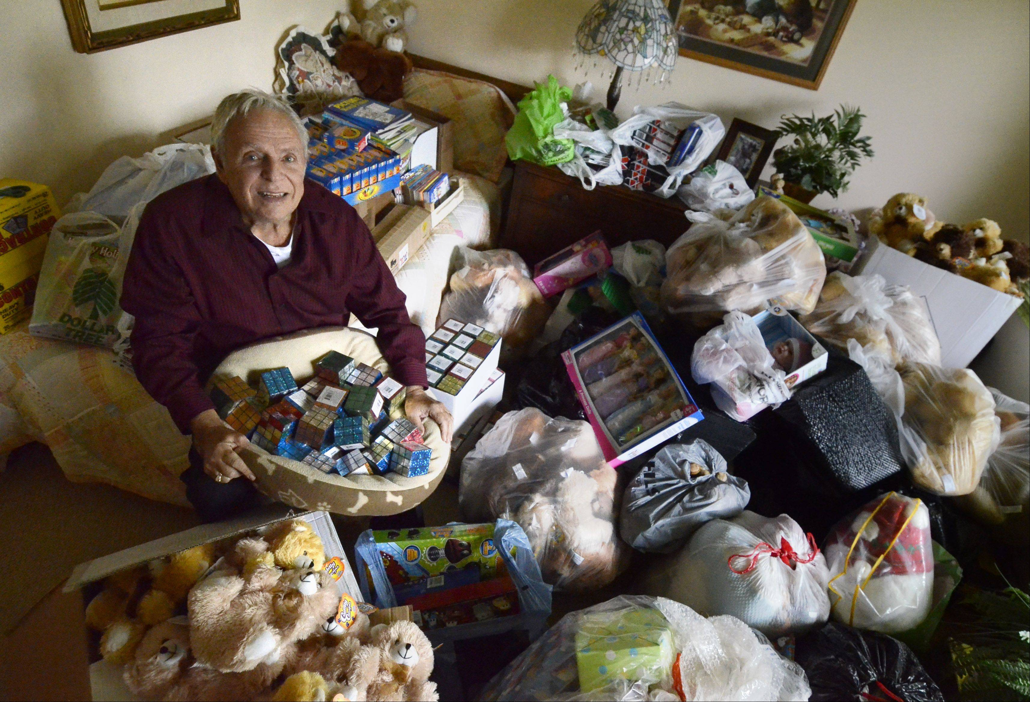 Jim Harney of Des Plaines squeezes in with some of the toys for this year's drive. He sorts them by age and by gender.