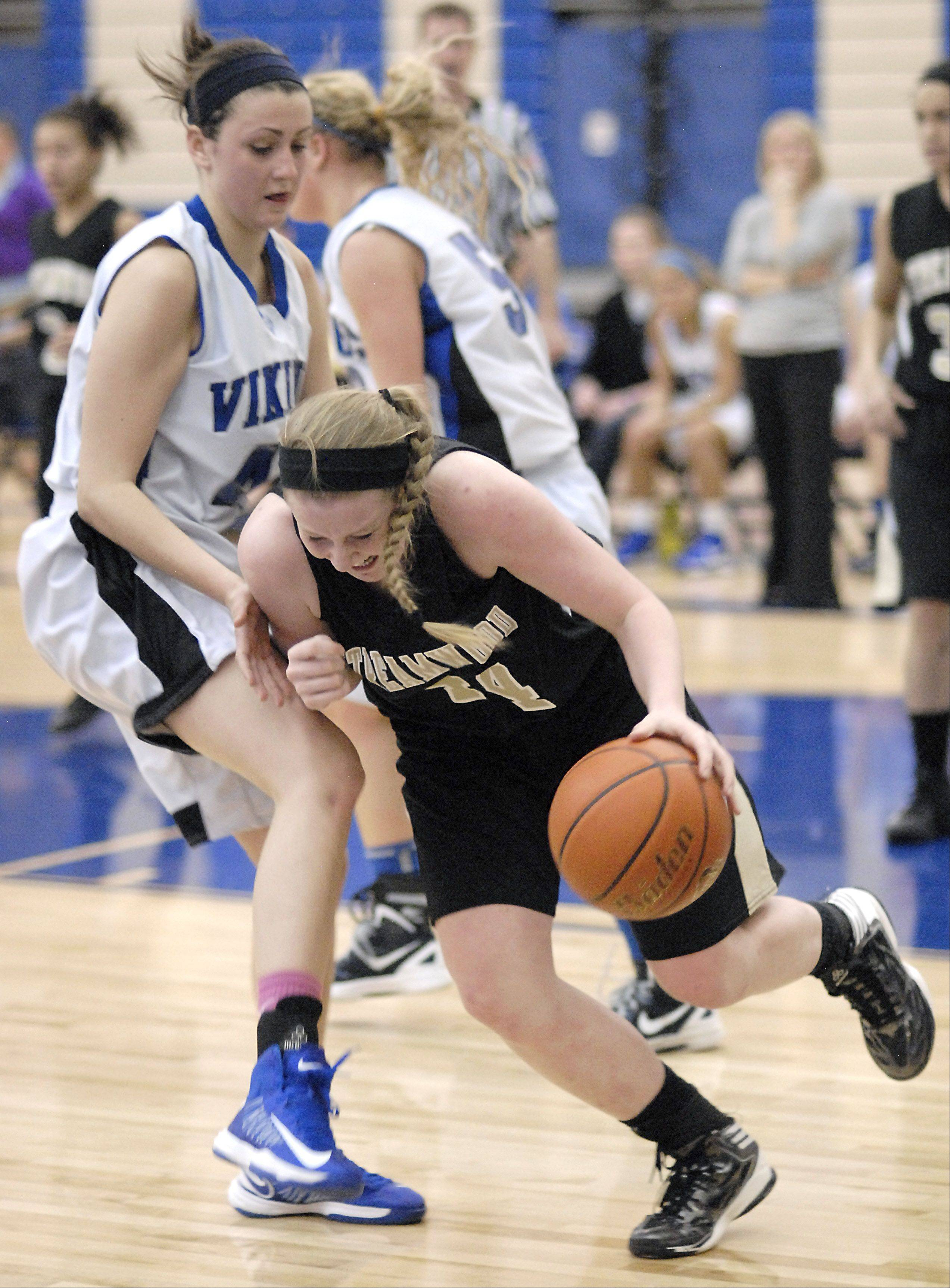 Streamwood's Hannah McGlone pushes her way past Geneva's Abby Novak after grabbing a Vikings rebound in the fourth quarter on Wednesday, December 12.