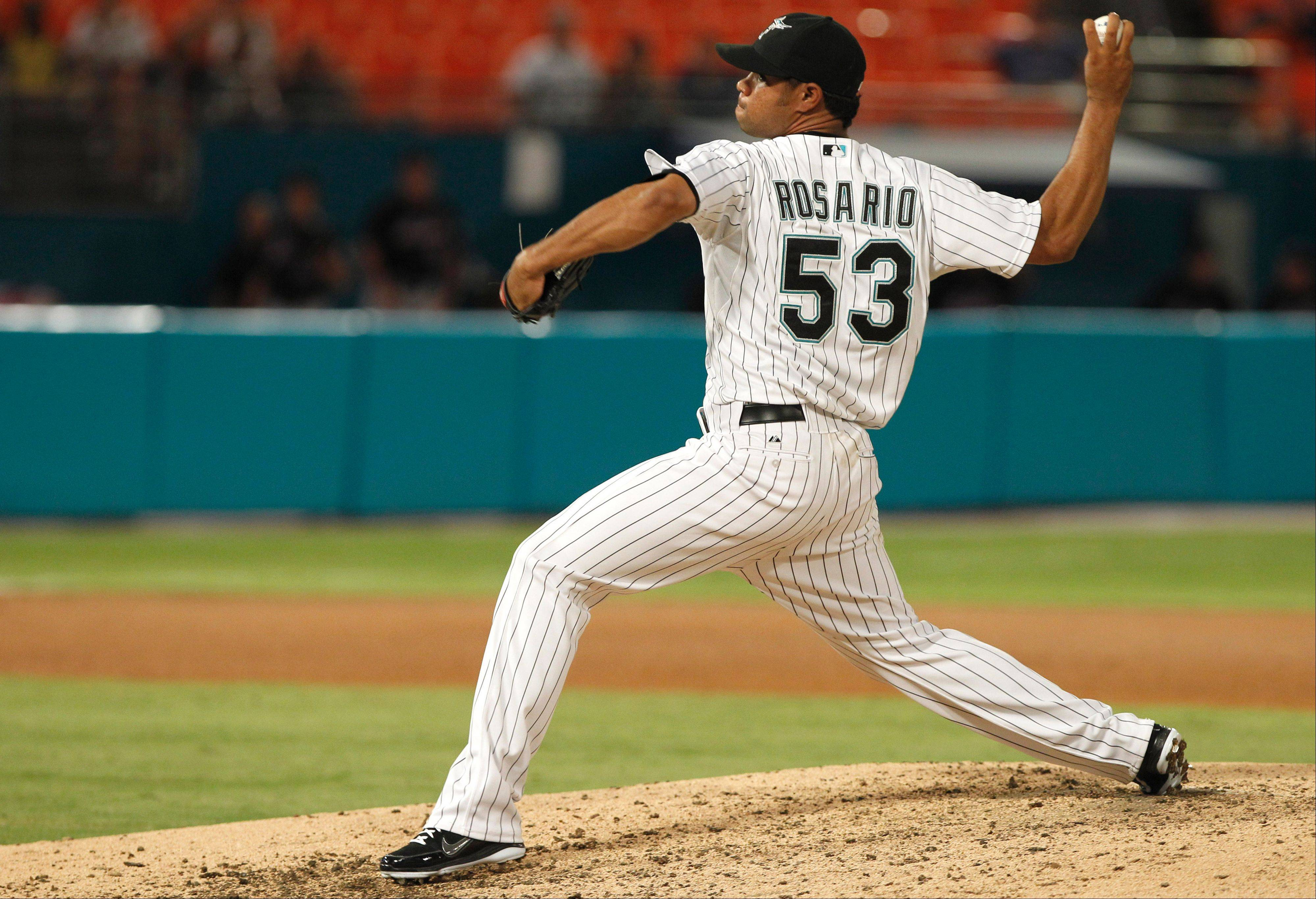 Relief pitcher Sandy Rosario, who last played for the Miami Marlins, was claimed by the Cubs off waivers from Boston.