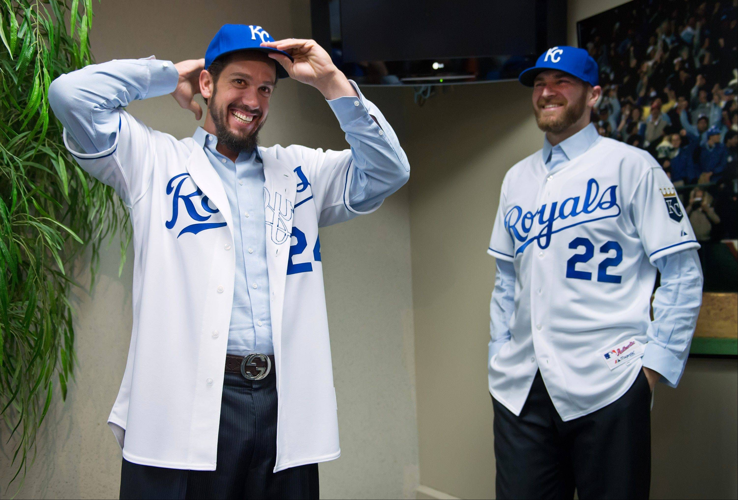 Kansas City Royals pitchers James Shields, left, and Wade Davis, right, pose in their jerseys and hats Wednesday during a news conference at Kauffman Stadium in Kansas City, Mo. The two pitchers arrived in Kansas City to undergo physicals and check out the stadium from the home clubhouse for the first time. Shields and Davis became members of the Royals on Sunday in a blockbuster trade that sent top prospect Wil Myers and three other minor leaguers to Tampa Bay.
