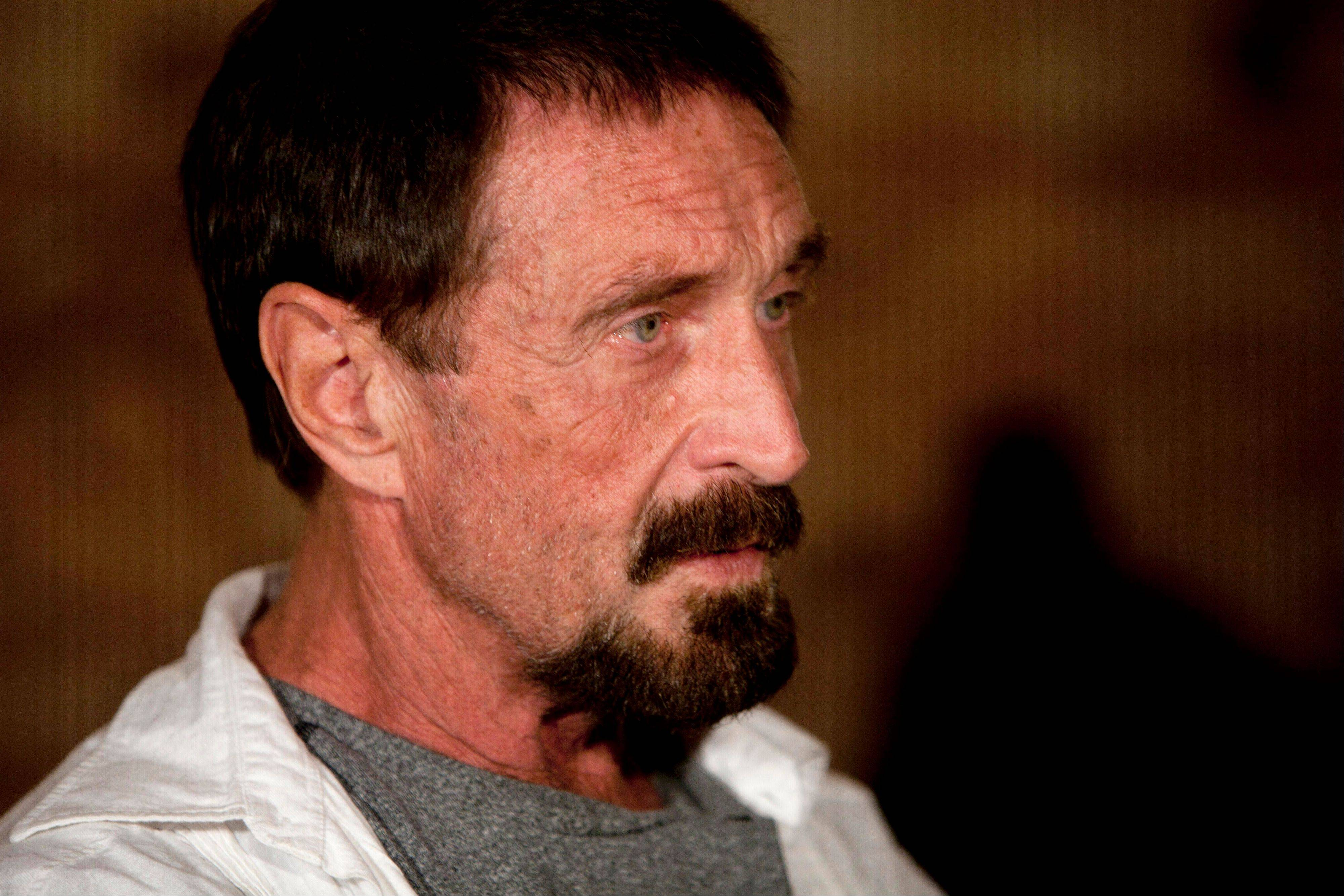 Software company founder John McAfee apparently is returning to the United States after having been detained in Guatemala since he sneaked there from neighboring Belize, where he was sought for questioning regarding the death of his neighbor.