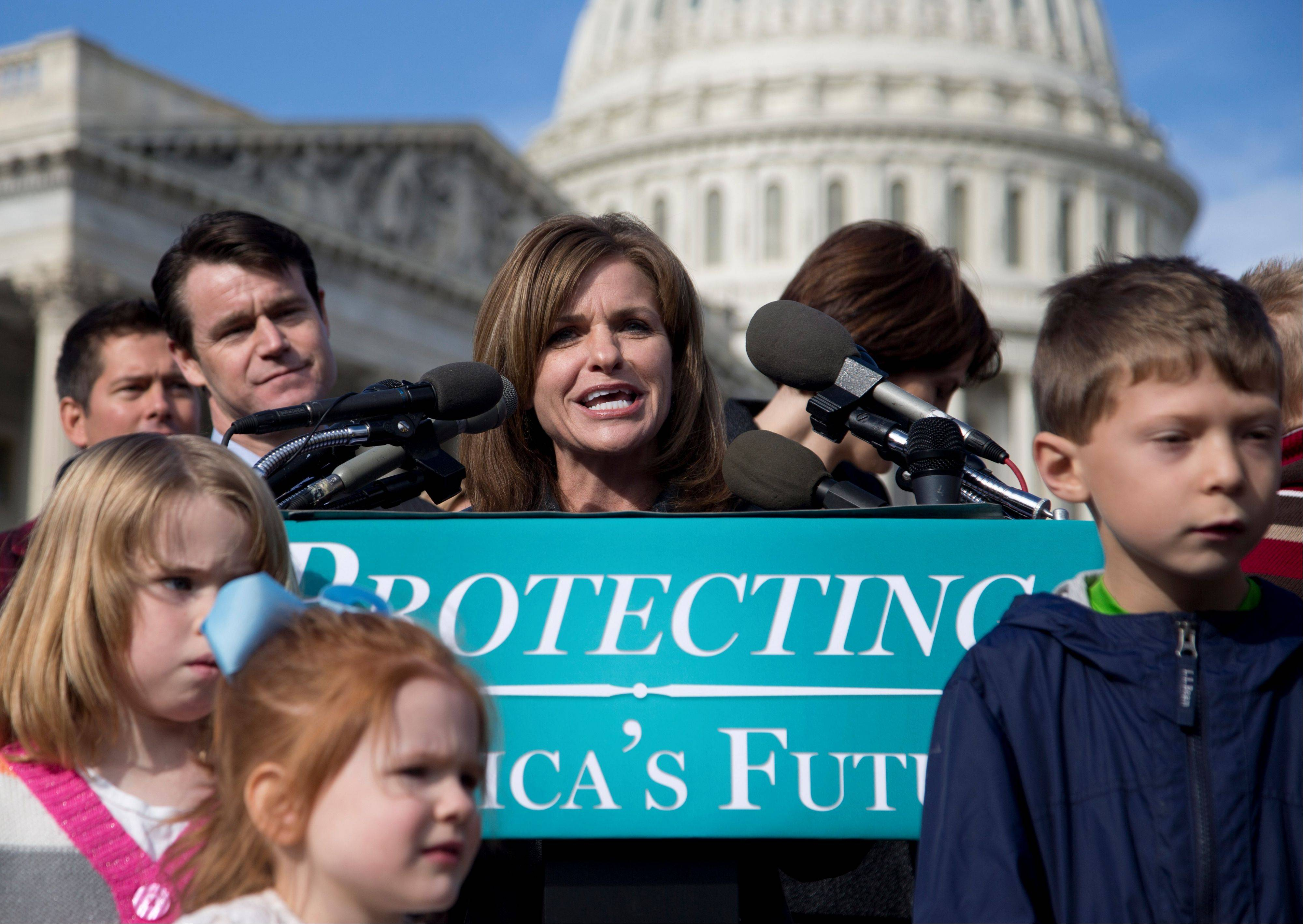Rep. Lynn Jenkins of Kansas, accompanied by fellow House Republicans, and others, speaks during a news conference on Capitol Hill in Washington Wednesday to talk about the effect of the national debt on American families.