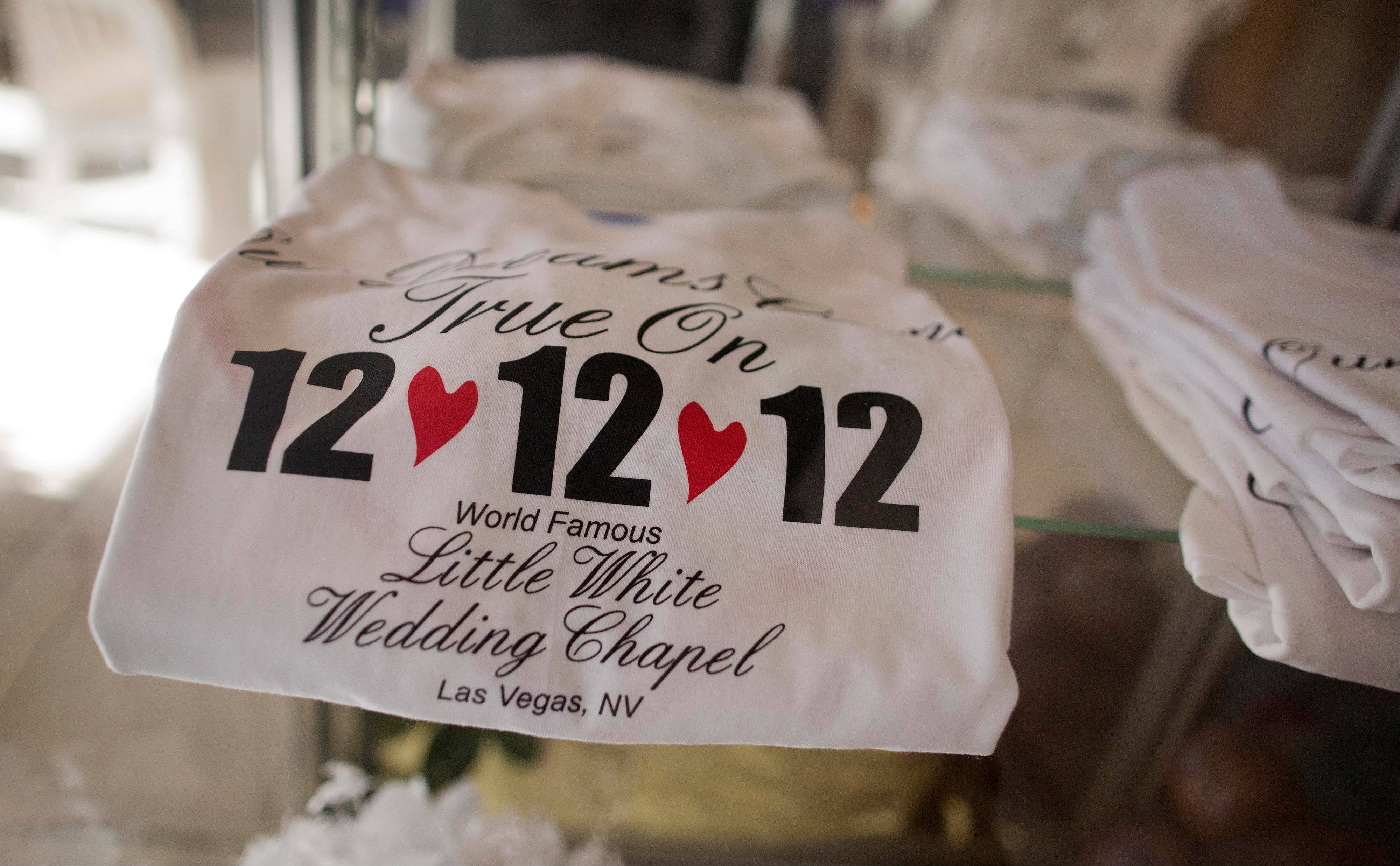 "T-shirts advertising the 12-12-12 date sit on display at A Little White Wedding Chapel, Tuesday, Dec. 11, 2012, in Las Vegas. These ""once-in-a-century"" wedding dates have become more important each year as people increasingly look outside Vegas for nontraditional weddings. Once known as the wedding capital of the world, Vegas' share of the U.S. wedding market has fallen by a third since 2004."