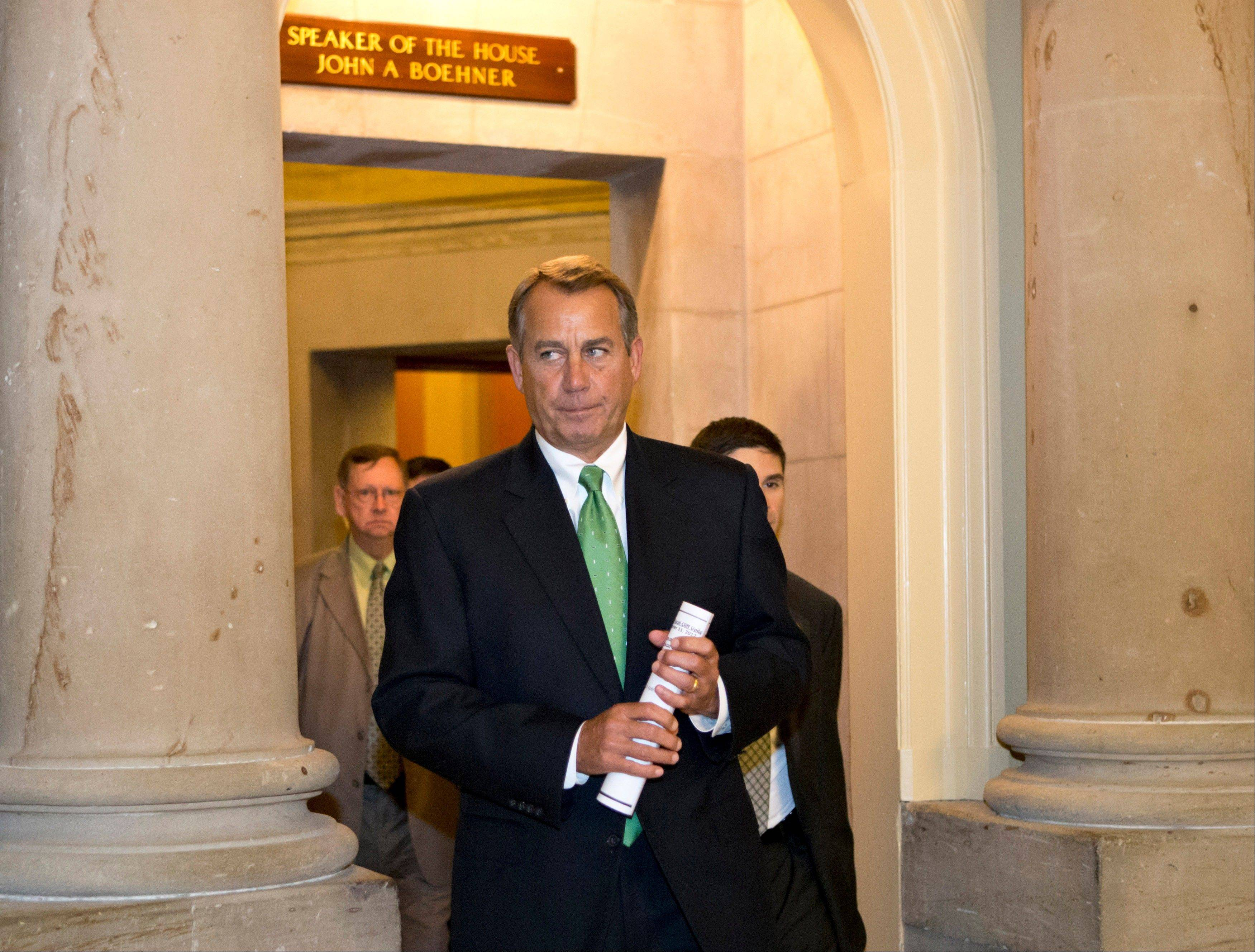 House Speaker John Boehner of Ohio leaves his office and walks to the House floor to deliver remarks about negotiations with President Obama on the fiscal cliff, on Capitol Hill in Washington.