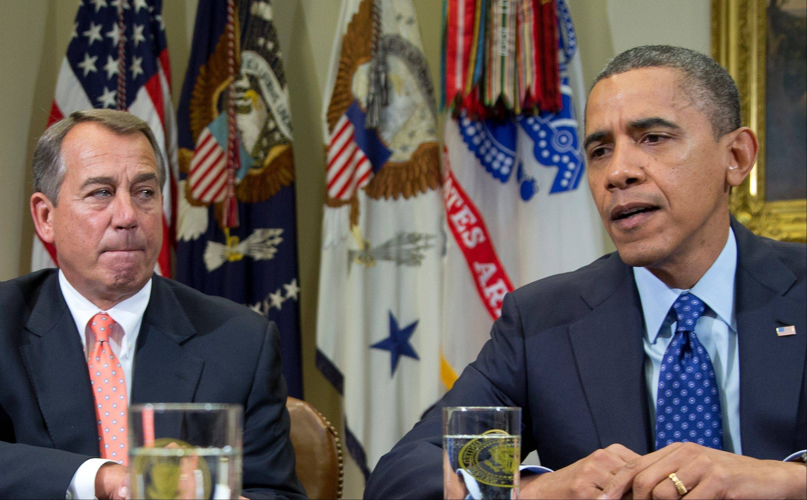 This Nov. 16, 2012 file photo shows President Barack Obama, accompanied by House Speaker John Boehner of Ohio, speaking to reporters in the Roosevelt Room of the White House in Washington.