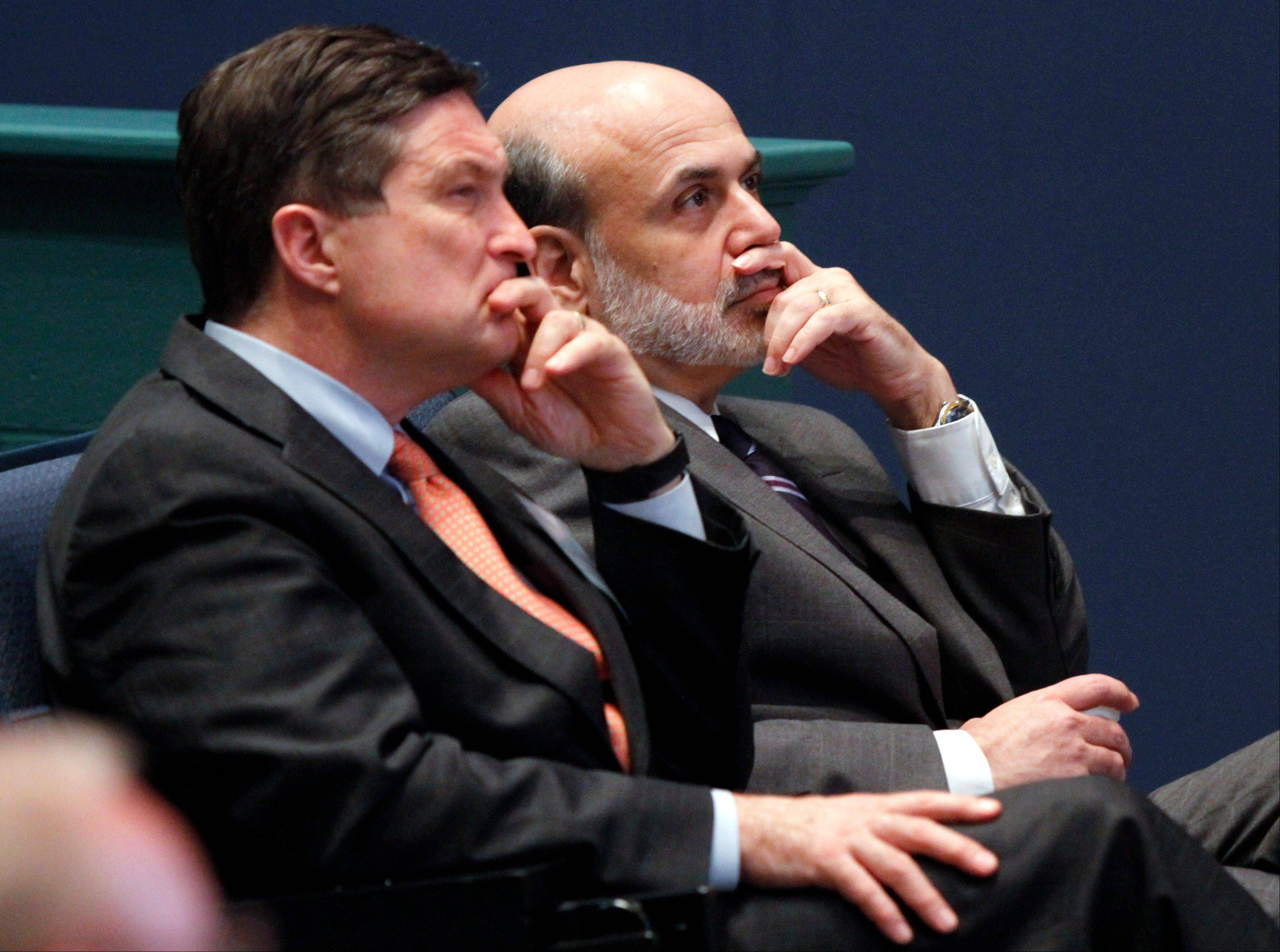 In this June 9, 2010, file photo, Federal Reserve Chairman, Ben Bernanke, right, listens with president of the Federal Reserve of Richmond, Jeffrey Lacker, left, at J. Sergeant Reynolds Community College in Richmond, Va.