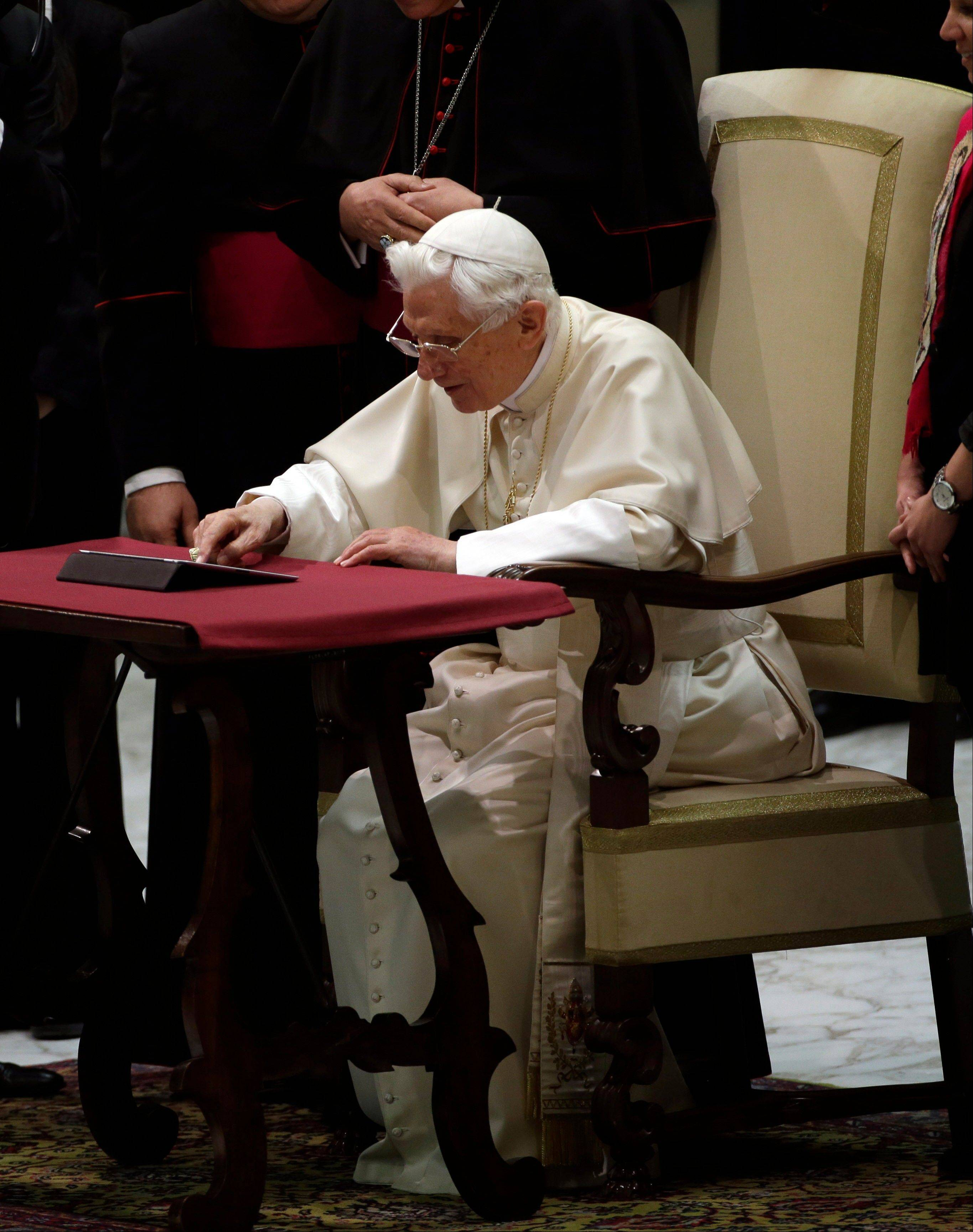 Pope Benedict XVI pushes a button on a tablet at the Vatican, Wednesday, Dec. 12, 2012. In perhaps the most drawn out Twitter launch ever, Pope Benedict XVI pushed the button on a tablet brought to him at the end of his general audience Wednesday.
