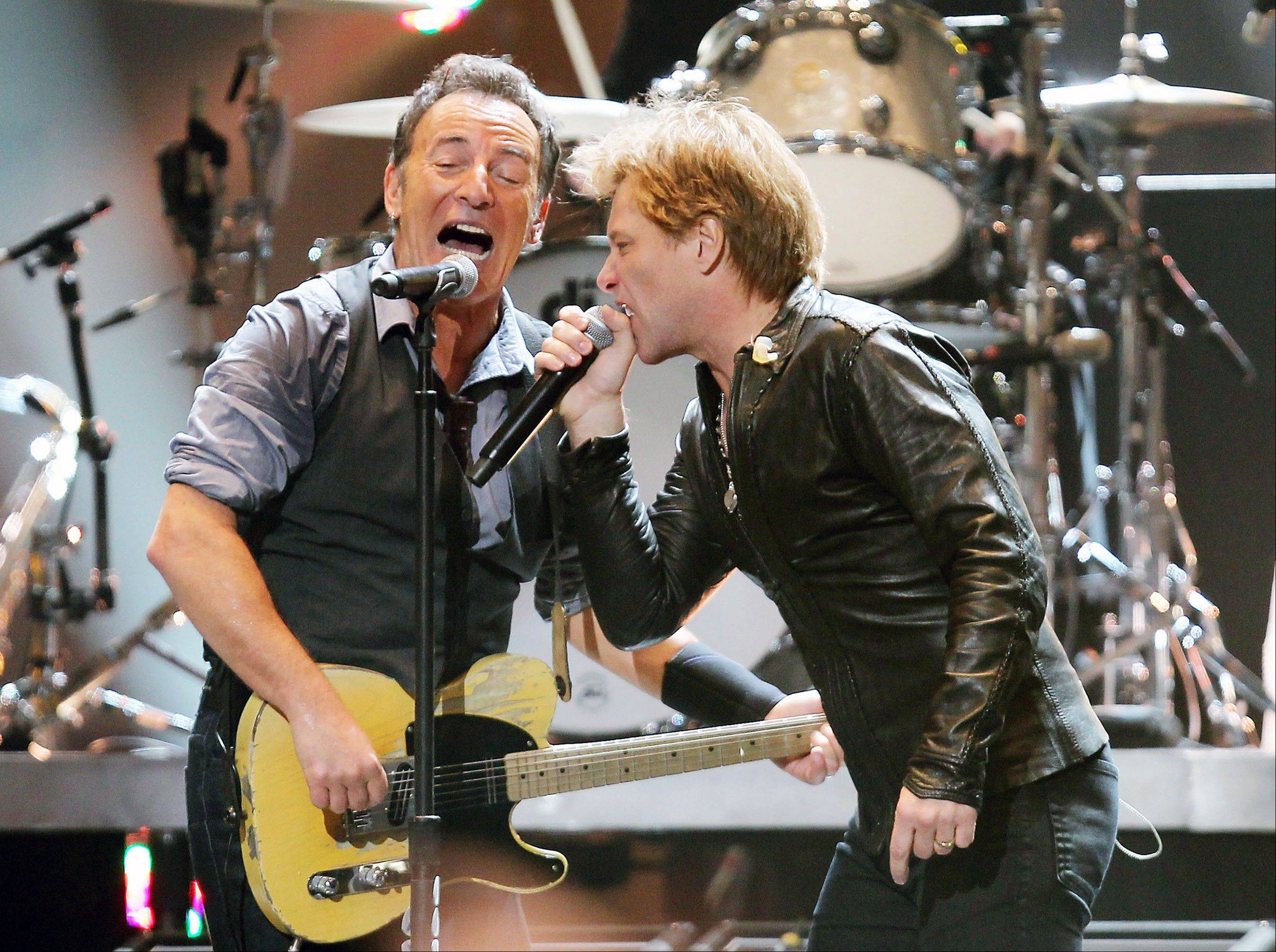 Bruce Springsteen, left, and Jon Bon Jovi perform Wednesday at the 12-12-12 The Concert for Sandy Relief at Madison Square Garden in New York. Proceeds from the show will be distributed through the Robin Hood Foundation.