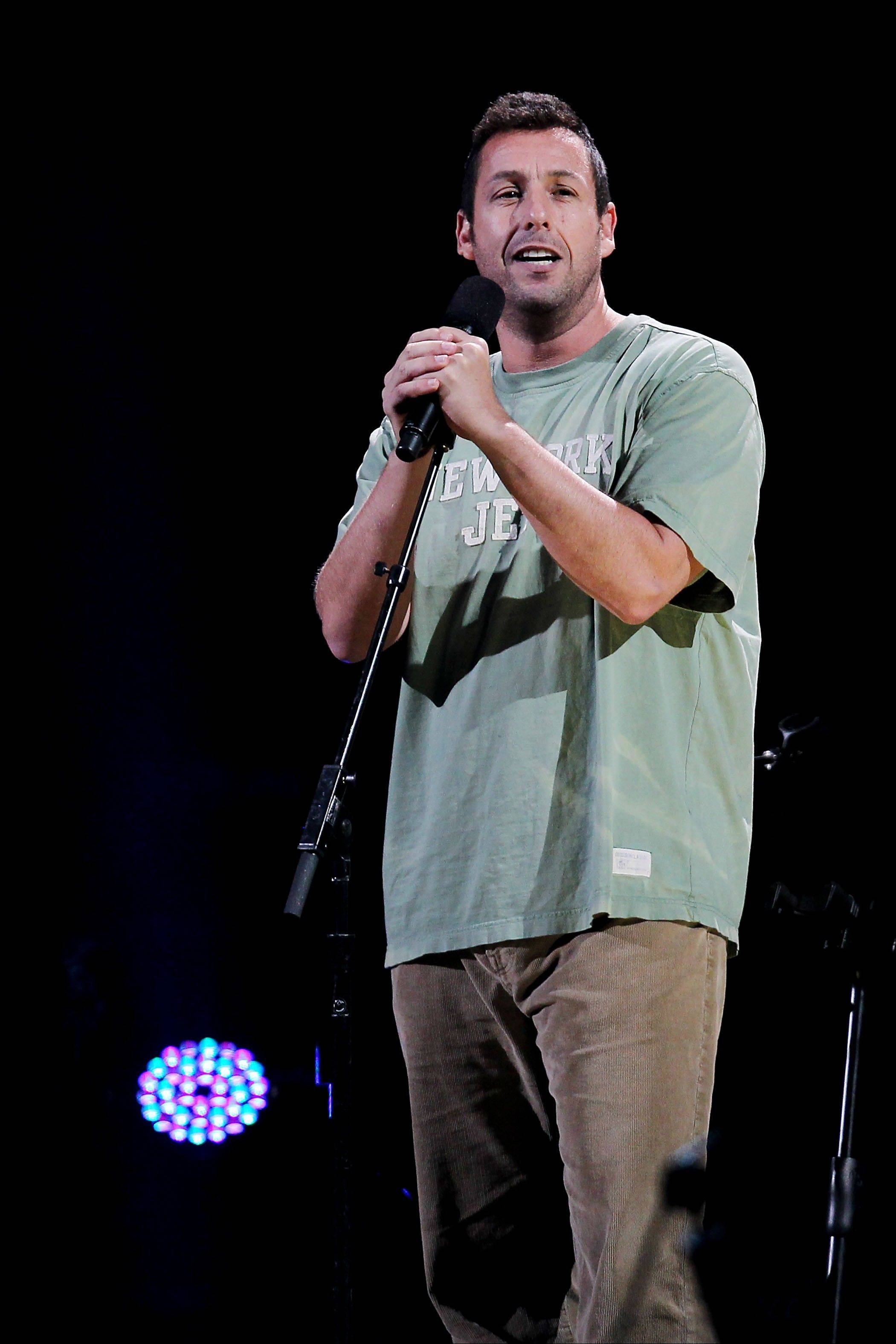 Adam Sandler performs Wednesday at the 12-12-12 The Concert for Sandy Relief at Madison Square Garden in New York.