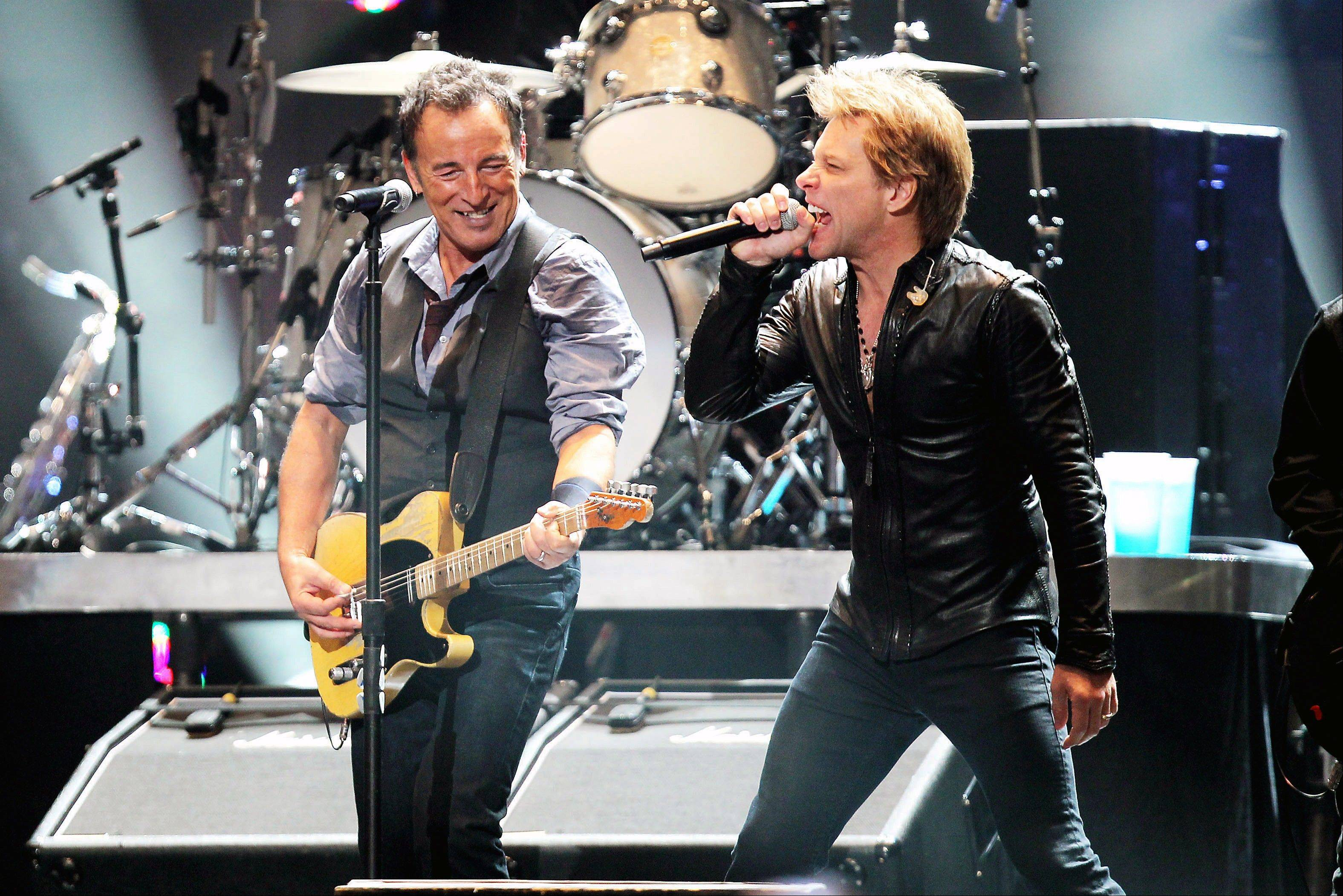 Bruce Springsteen, left, and Jon Bon Jovi perform Wednesday at the 12-12-12 The Concert for Sandy Relief at Madison Square Garden in New York.