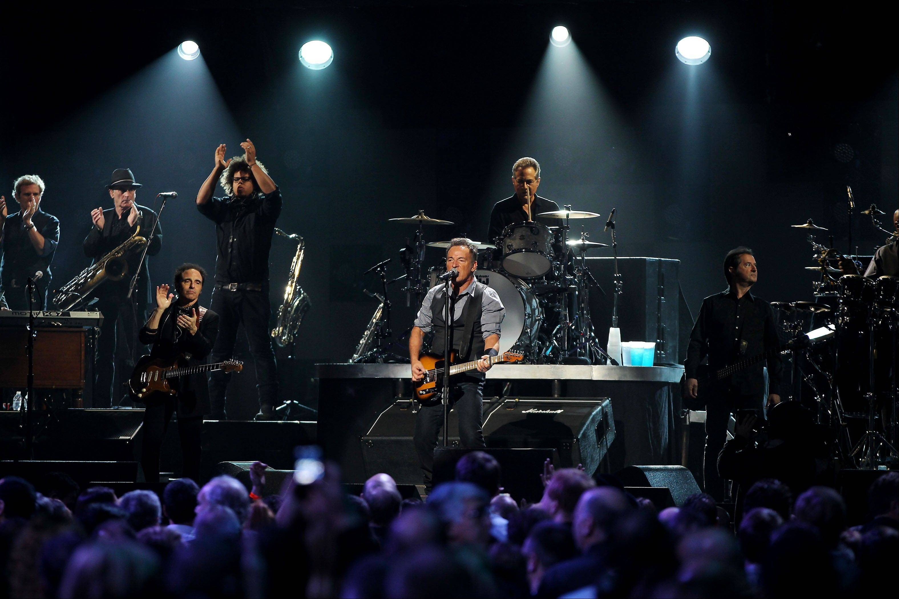 Bruce Springsteen and the E Street Band perform Wednesday at the 12-12-12 The Concert for Sandy Relief at Madison Square Garden in New York.