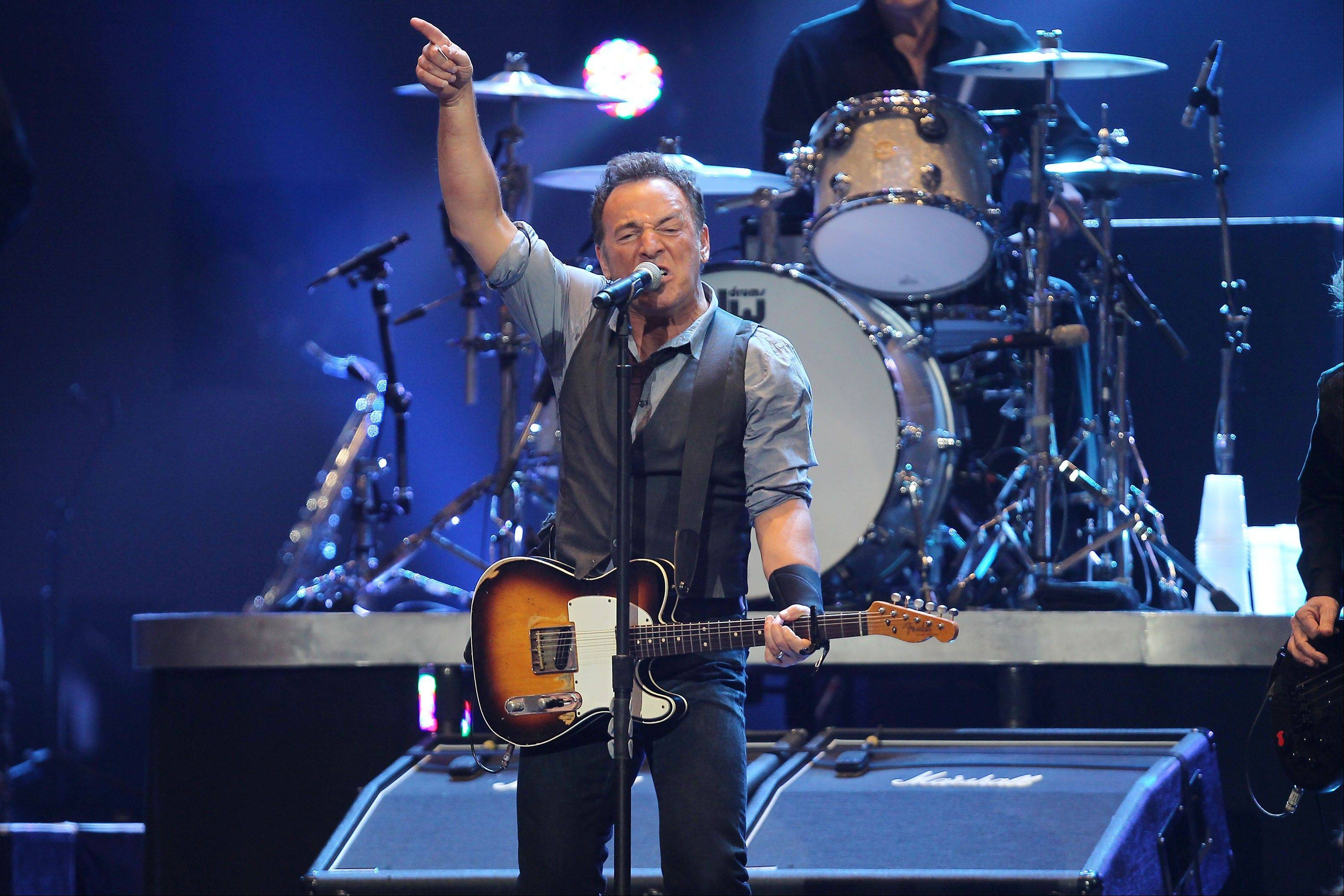 Bruce Springsteen performs Wednesday at the 12-12-12 The Concert for Sandy Relief at Madison Square Garden in New York.