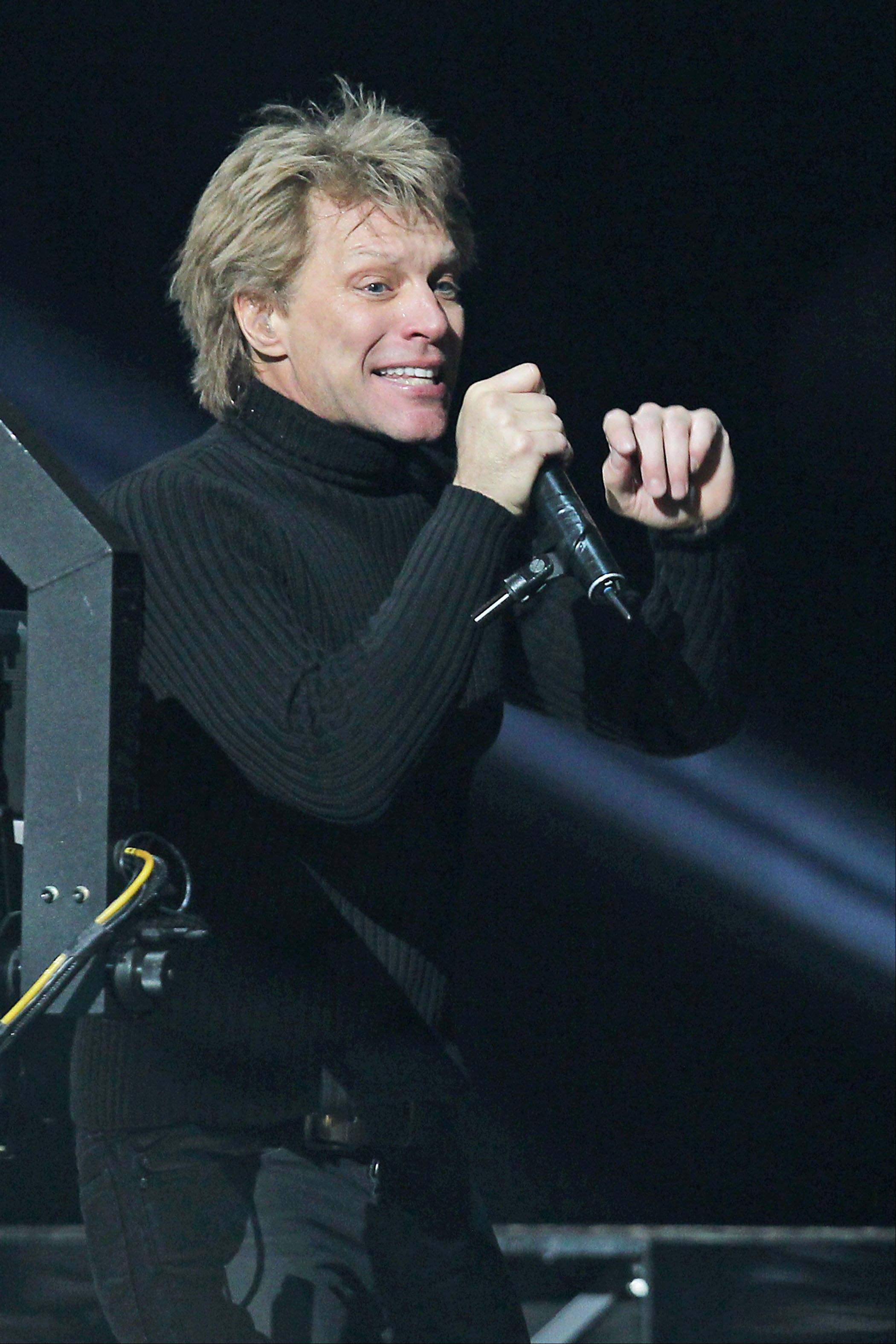 Jon Bon Jovi performs Wednesday at the 12-12-12 The Concert for Sandy Relief at Madison Square Garden in New York.