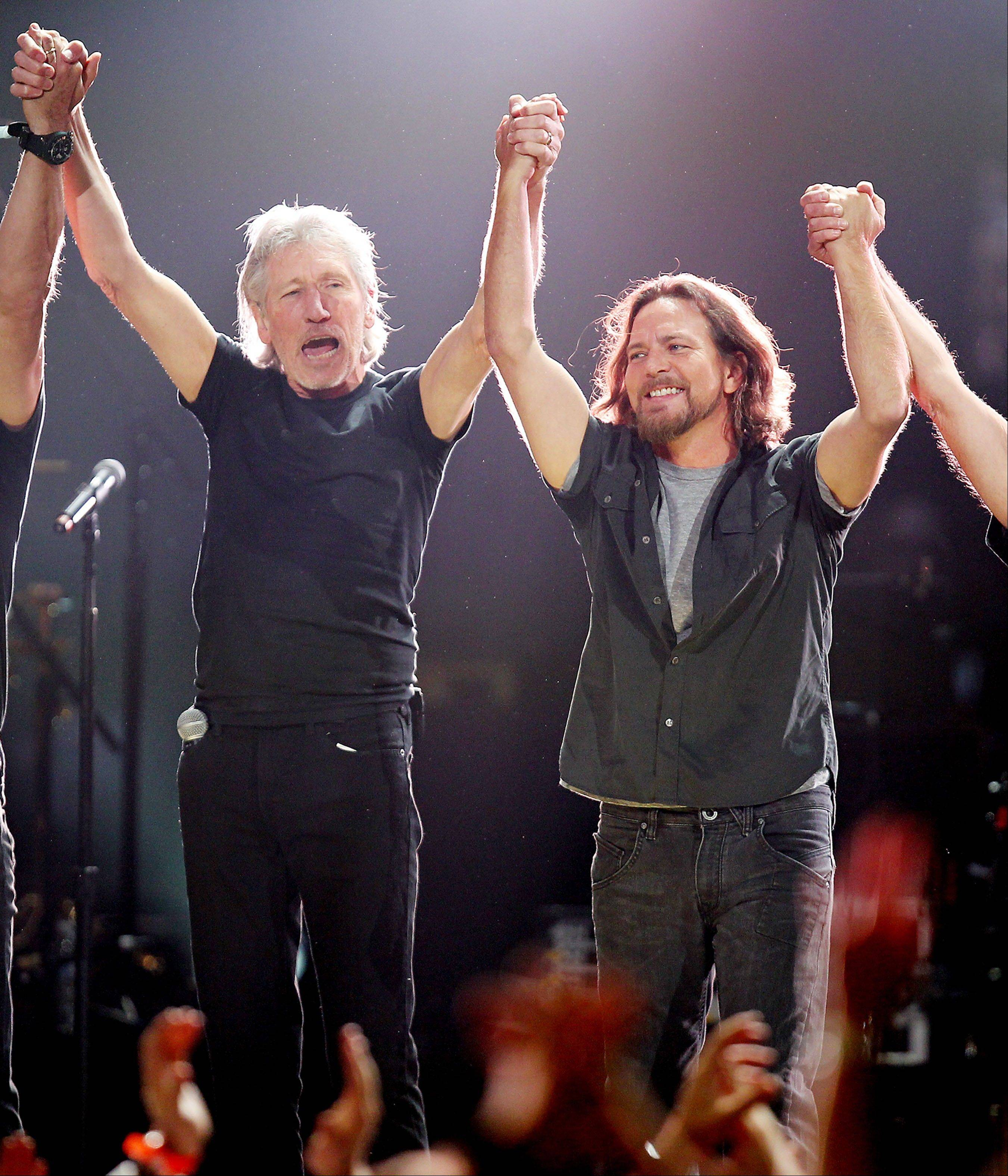 Roger Waters, left, and Eddie Vedder at the 12-12-12 The Concert for Sandy Relief at Madison Square Garden in New York.