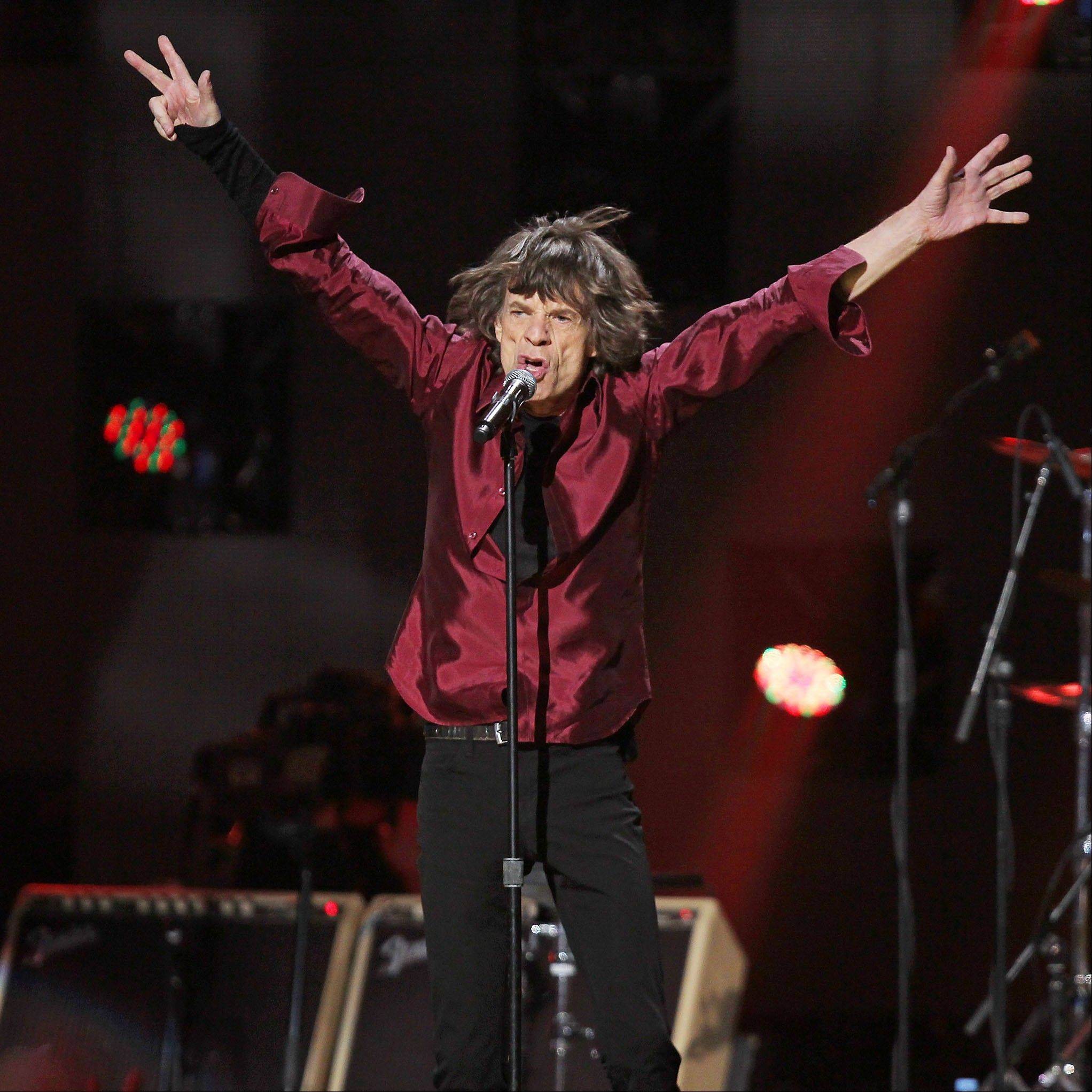 Mick Jagger of The Rolling Stones performs Wednesday at the 12-12-12 The Concert for Sandy Relief at Madison Square Garden in New York.
