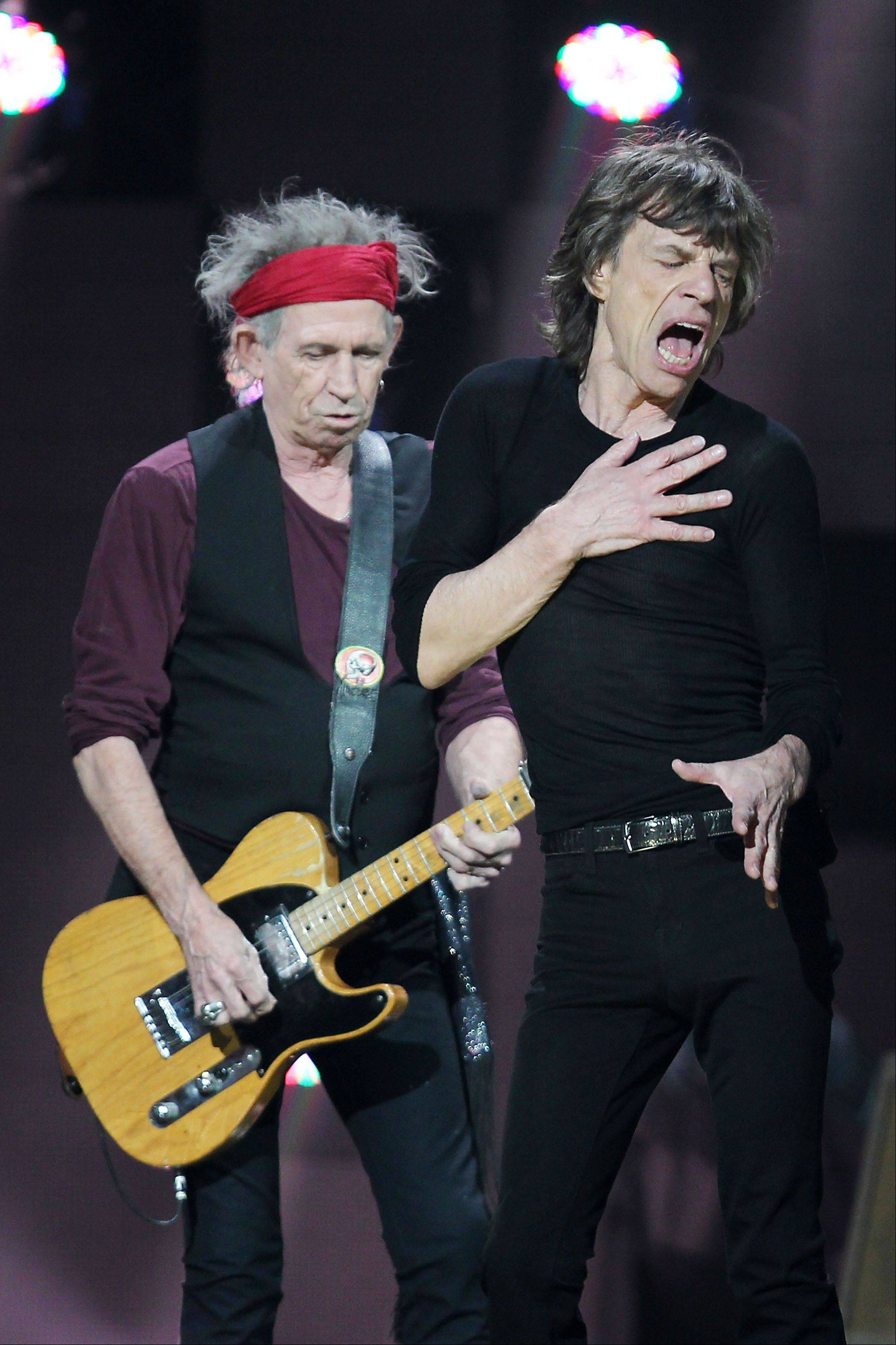 Keith Richards, left, and Mick Jagger of The Rolling Stones performs Wednesday at the 12-12-12 The Concert for Sandy Relief at Madison Square Garden in New York.