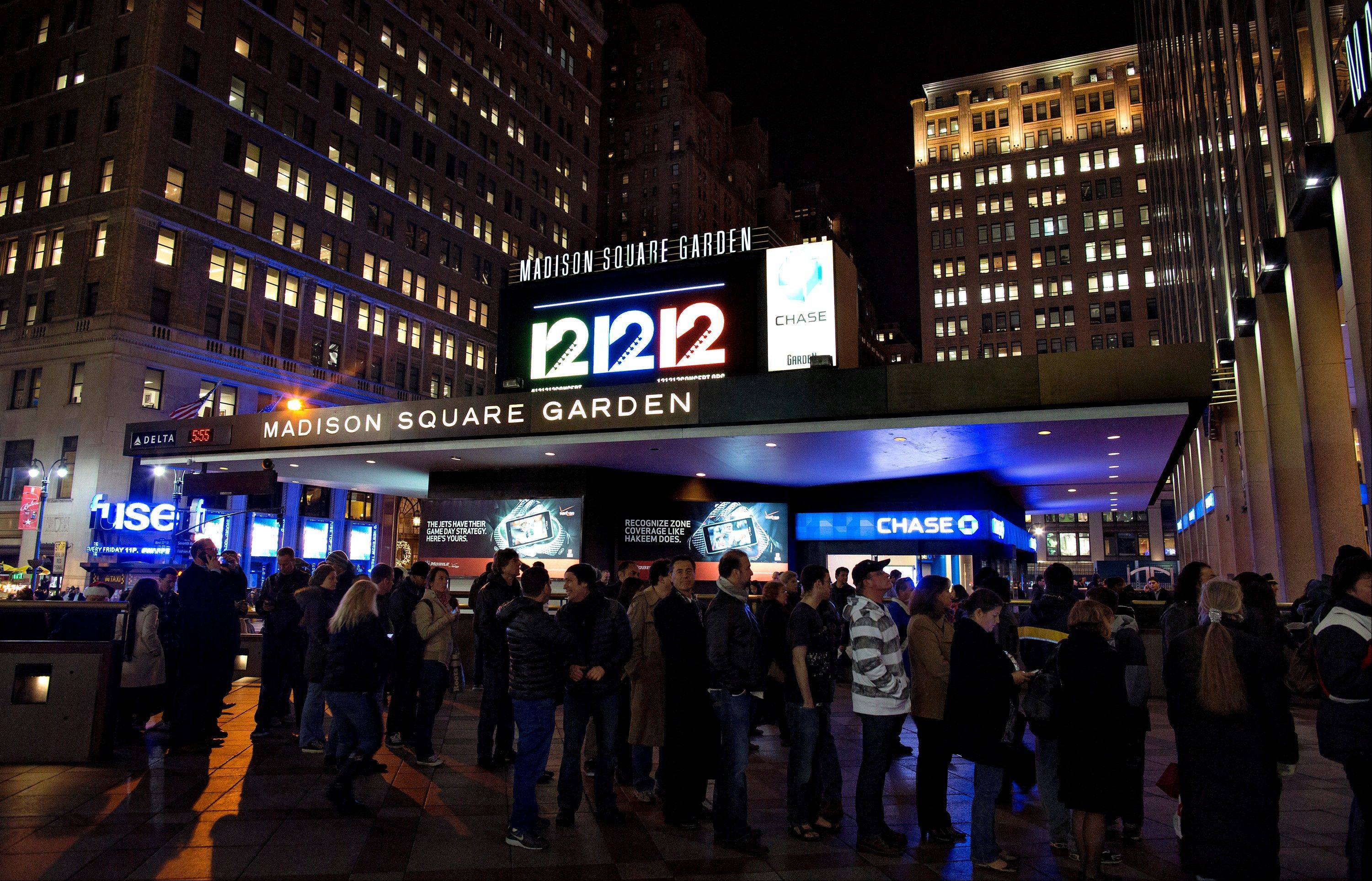 "People gather Wednesday before the ""12-12-12"" benefit concert at Madison Square Garden in New York. Music royalty from the Rolling Stones to Kanye West are gathering at Madison Square Garden Wednesday for a benefit concert to help storm victims."