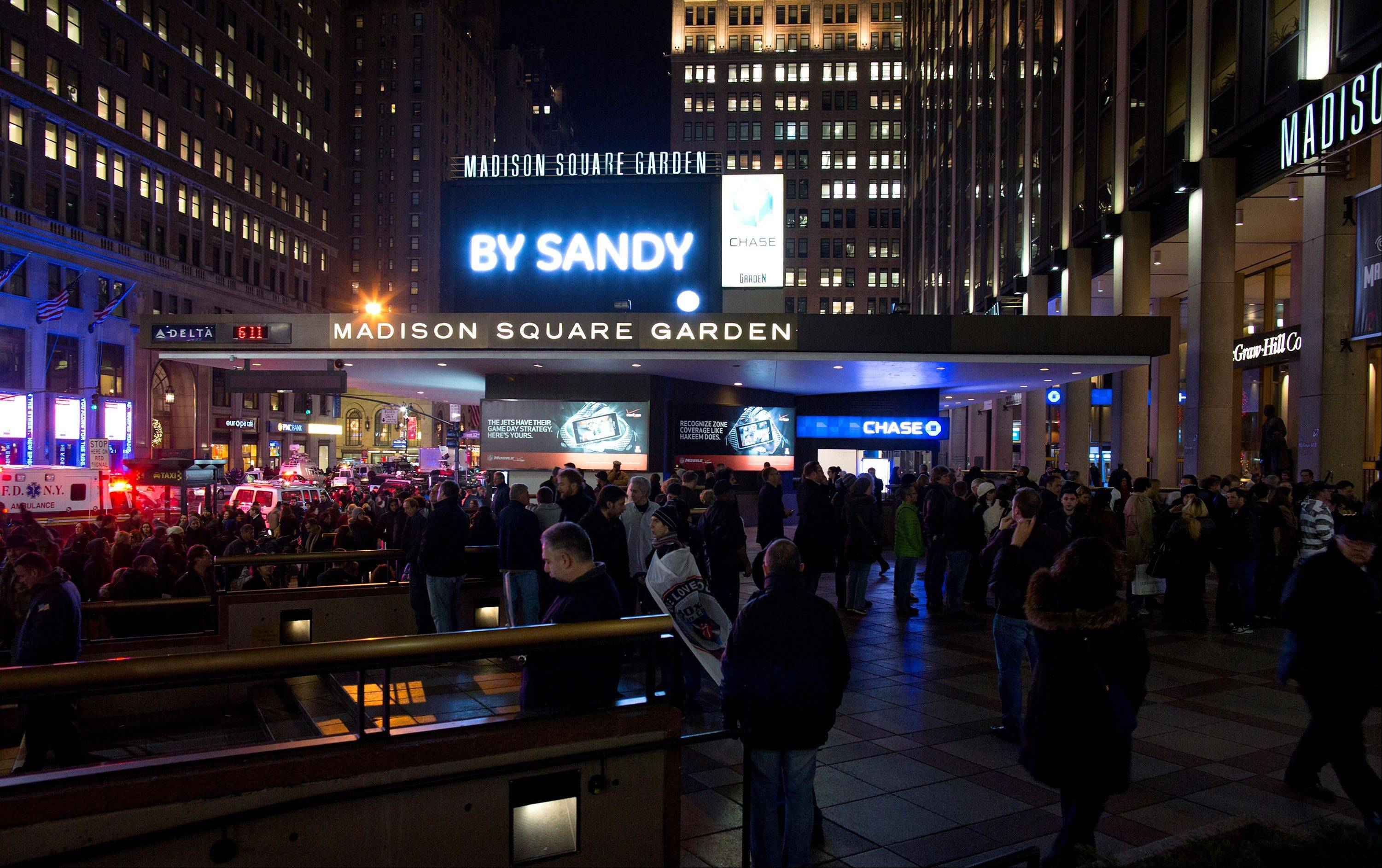 "People gather Wednesday before the ""12-12-12"" benefit concert for Sandy relief at Madison Square Garden in New York."