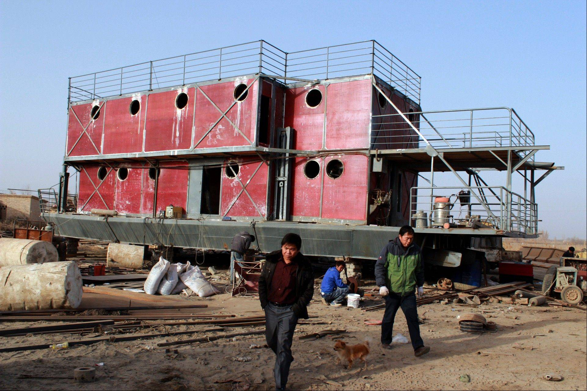 Lu Zhenghai has spent his life savings building the 70-foot-by-50-foot vessel powered by three diesel engines to help save him when he believes a flood will hit China on Dec. 21.
