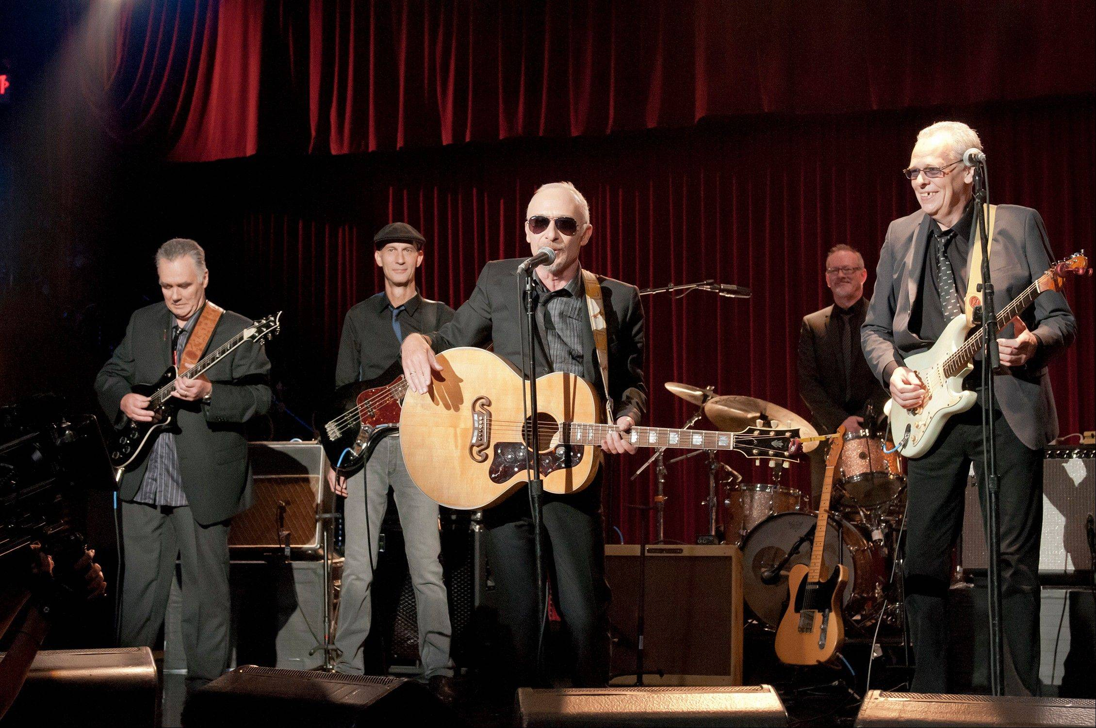 "In Judd Apatow's ""This is 40,"" Graham Parker, center, stars as an artist forgotten by time. His new album and tour has been timed to coincide with the movie, coming out Dec. 21."
