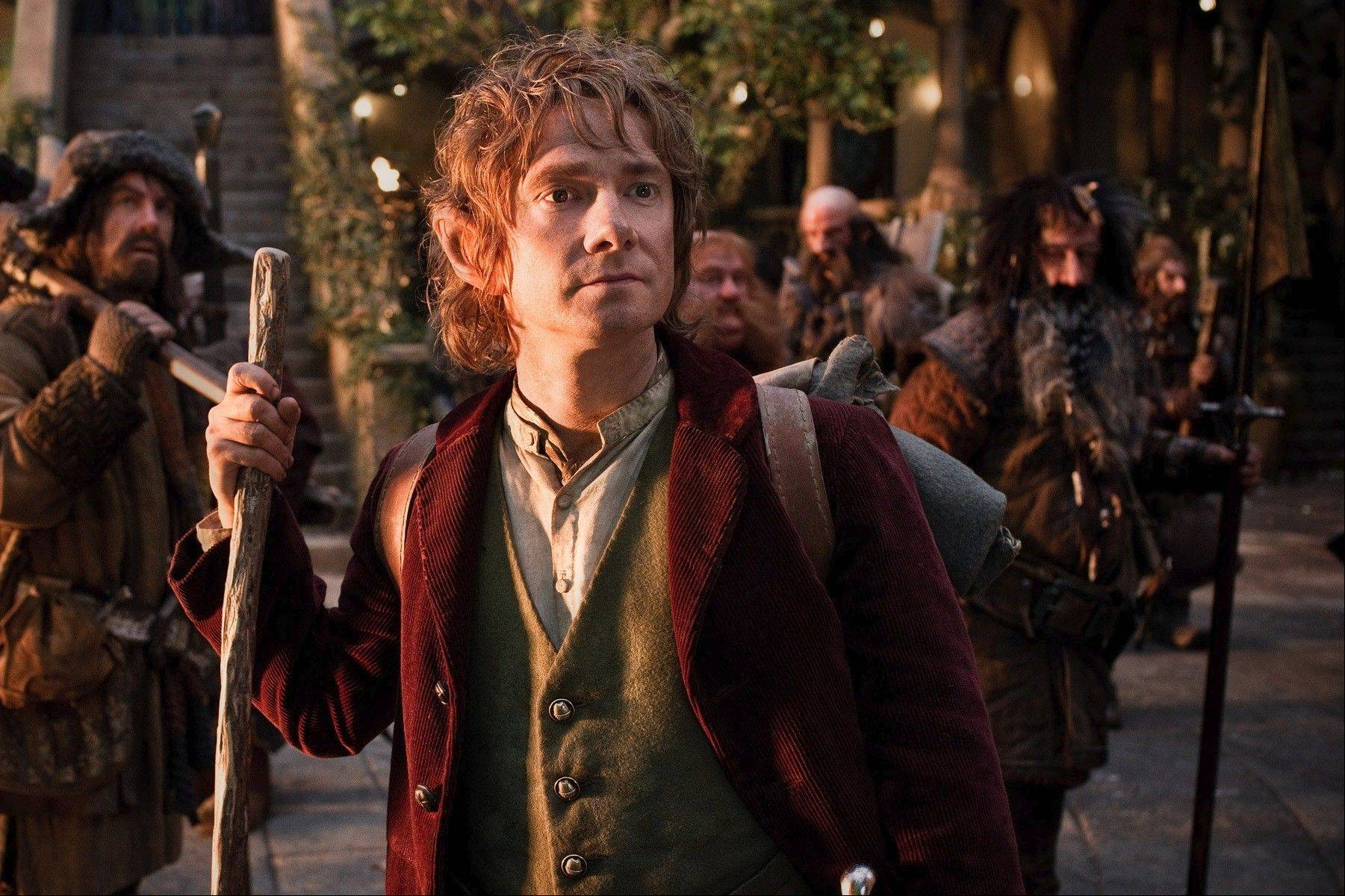 "Bilbo Baggins (Martin Freeman) accompanies a wizard and a group of dwarves in Peter Jackson's prequel ""The Hobbit: An Unexpected Journey."""