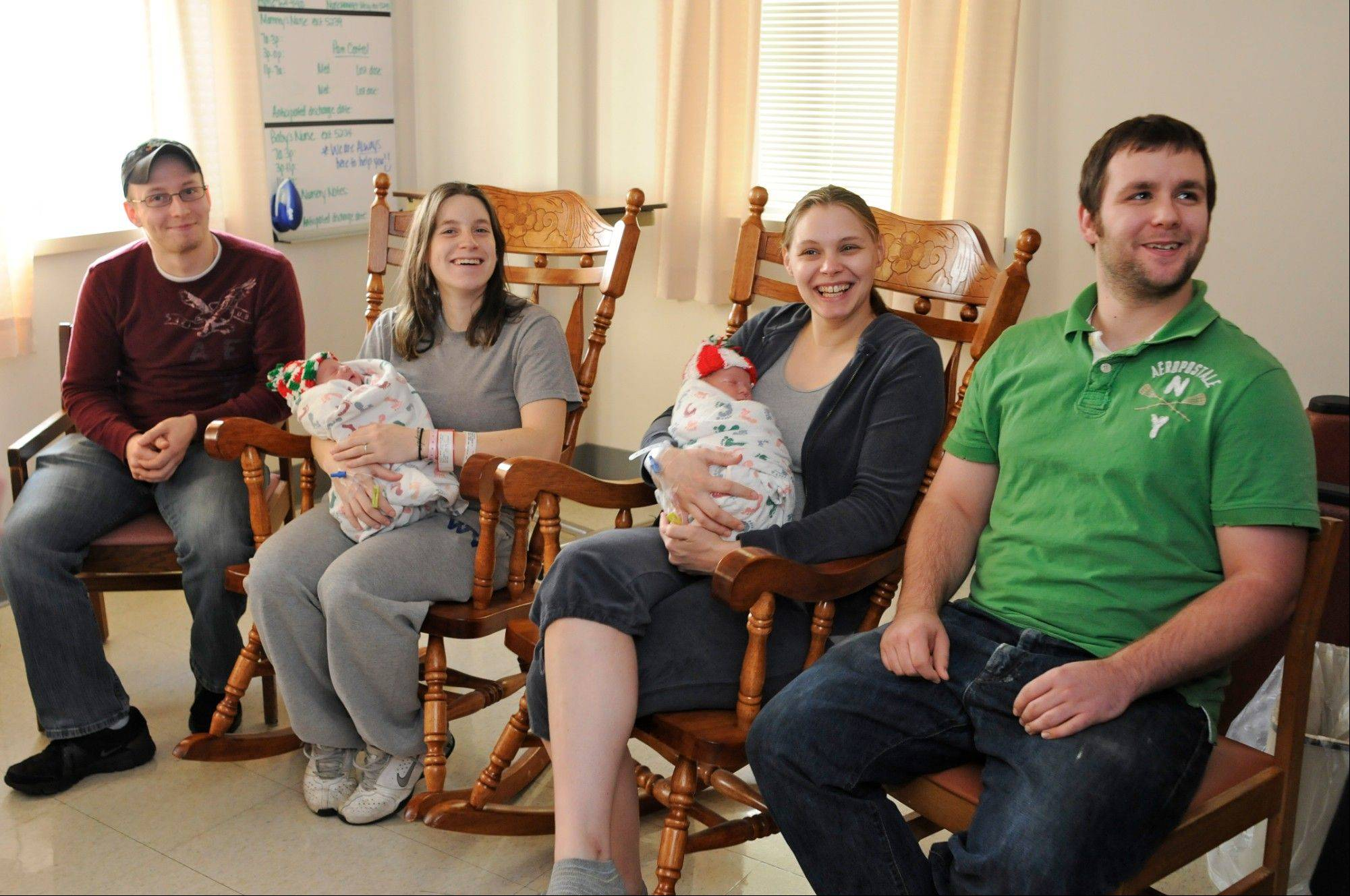 From left, Kurtis Lee King, and Ashley Morris, with daughter Ainsley, all of Williamstown, Pa., Rachel Krise, and Adam Jamison, with their son, Jet Ryan, all of Pottsville, Pa., enjoy a moment Wednesday during an interview with their newborn babies at The Birthplace Schuylkill Medical Center South Jackson Street in Pottsville, Pa.