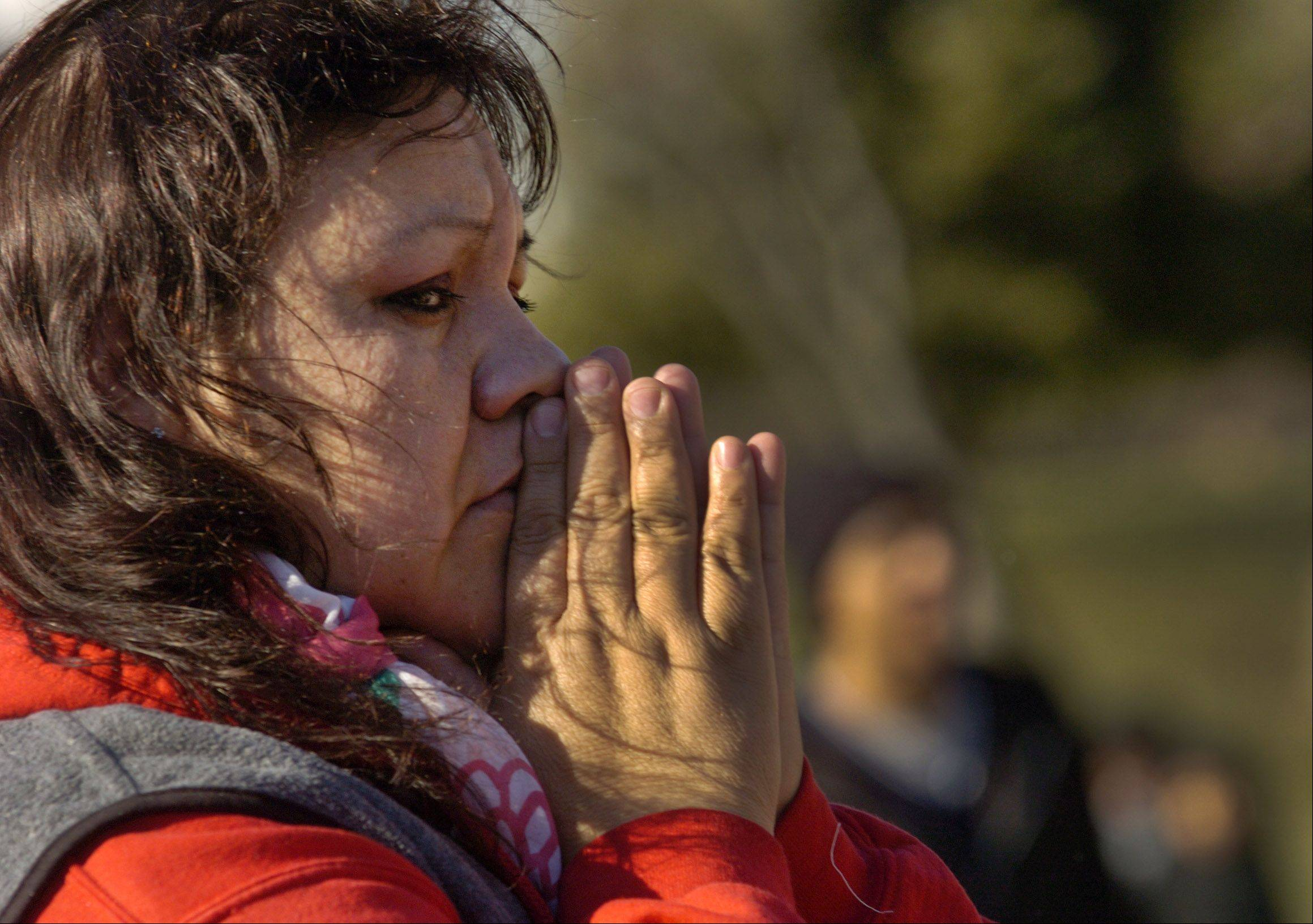 A pilgrim prays at Our Lady of Guadalupe shrine in Des Plaines.