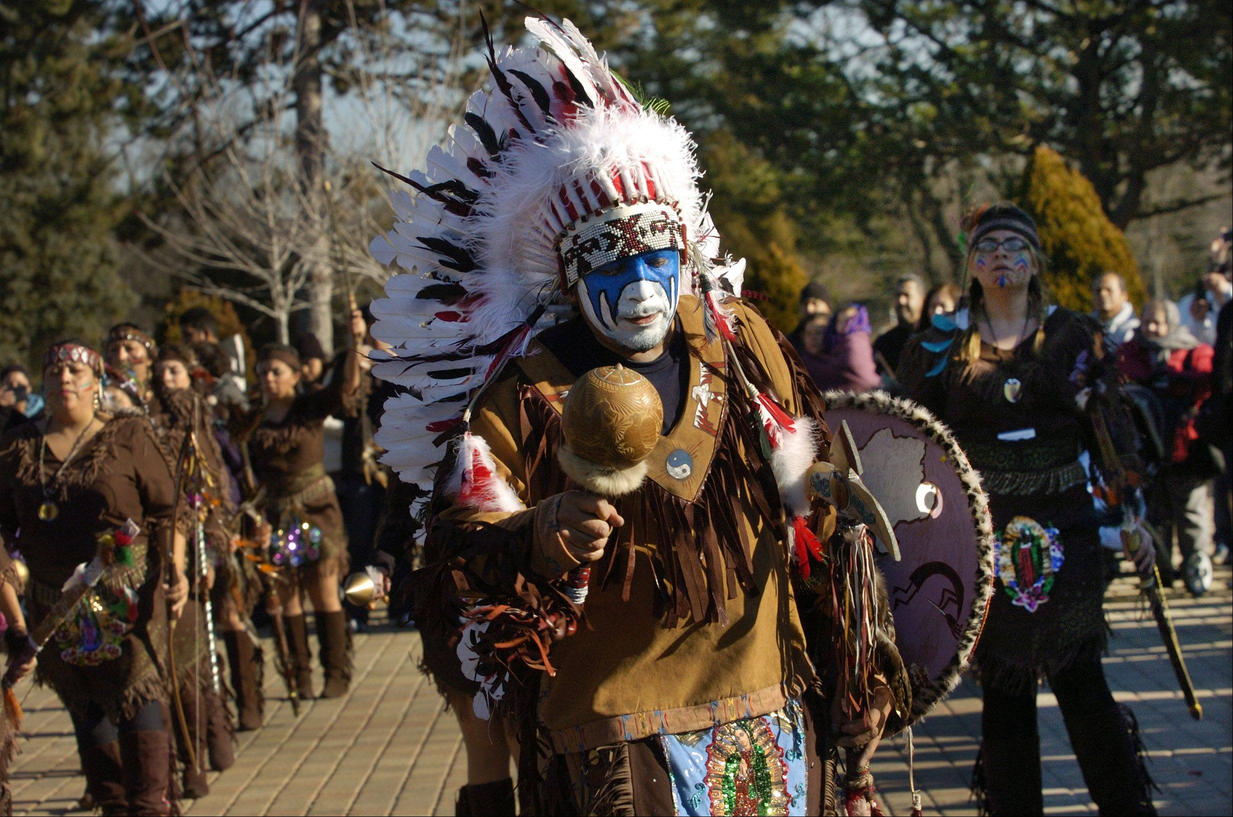 Victor Rodriguez and Danza Devocion Guadalupana perform an indigenous Mexican Indian ritual dance in front of the Our Lady of Guadalupe shrine in Des Plaines.