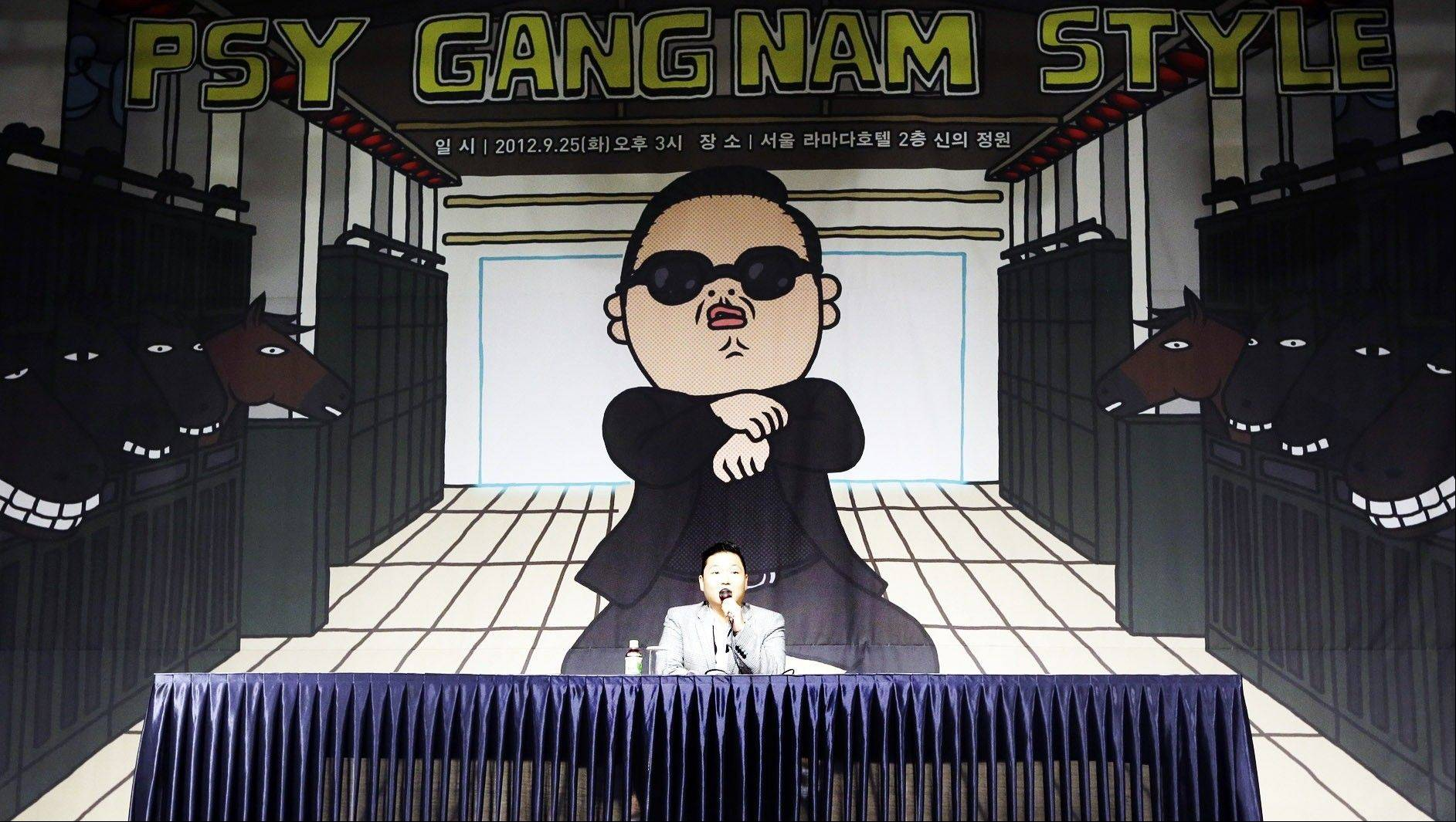 "South Korean rapper PSY, who sings the popular ""Gangnam Style"" song, answers reporters' question during a news conference in Seoul, South Korea. In Google's 12th annual roundup of trending searches, PSY's ""Gangnam Style"" music video trotted into second spot in 2012, a testament to his self-deprecating giddy-up dance move."