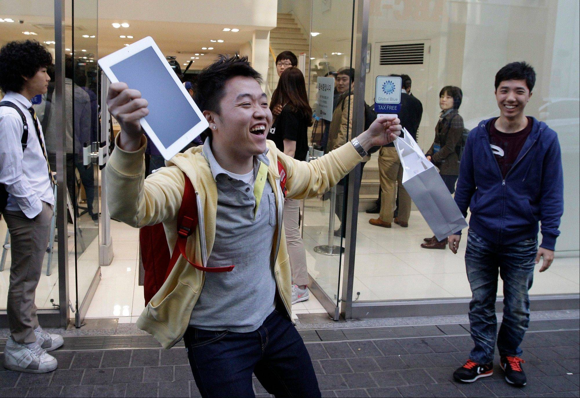 Baek Sung-min, 23, reacts after purchasing a new iPad at an Apple store in Seoul, South Korea. In Google's 12th annual roundup of global trending searches, the iPad 3 was ranked fourth.