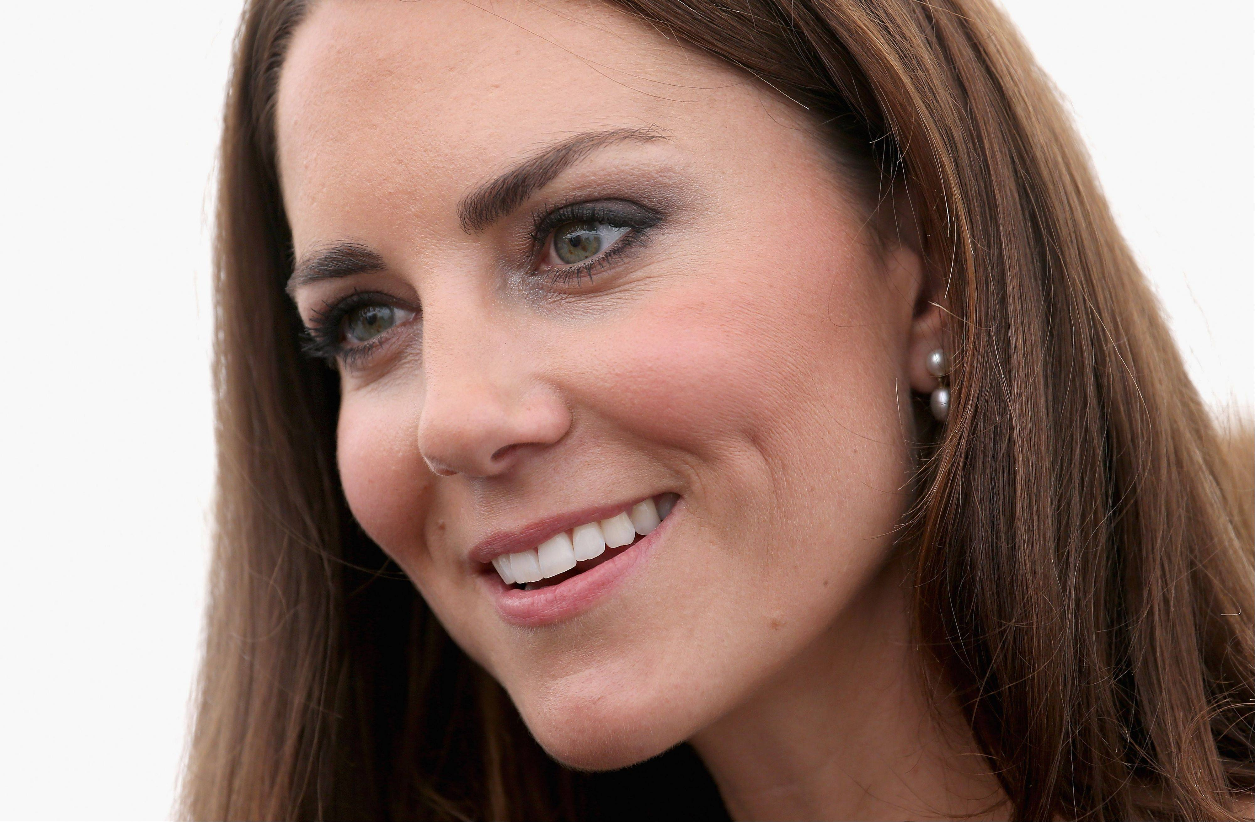 Britain's Kate Middleton, the Duchess of Cambridge, attends a reception as she visits Bacon's College in London. In Google's 12th annual roundup of global trending searches, Kate Middleton was ranked sixth.