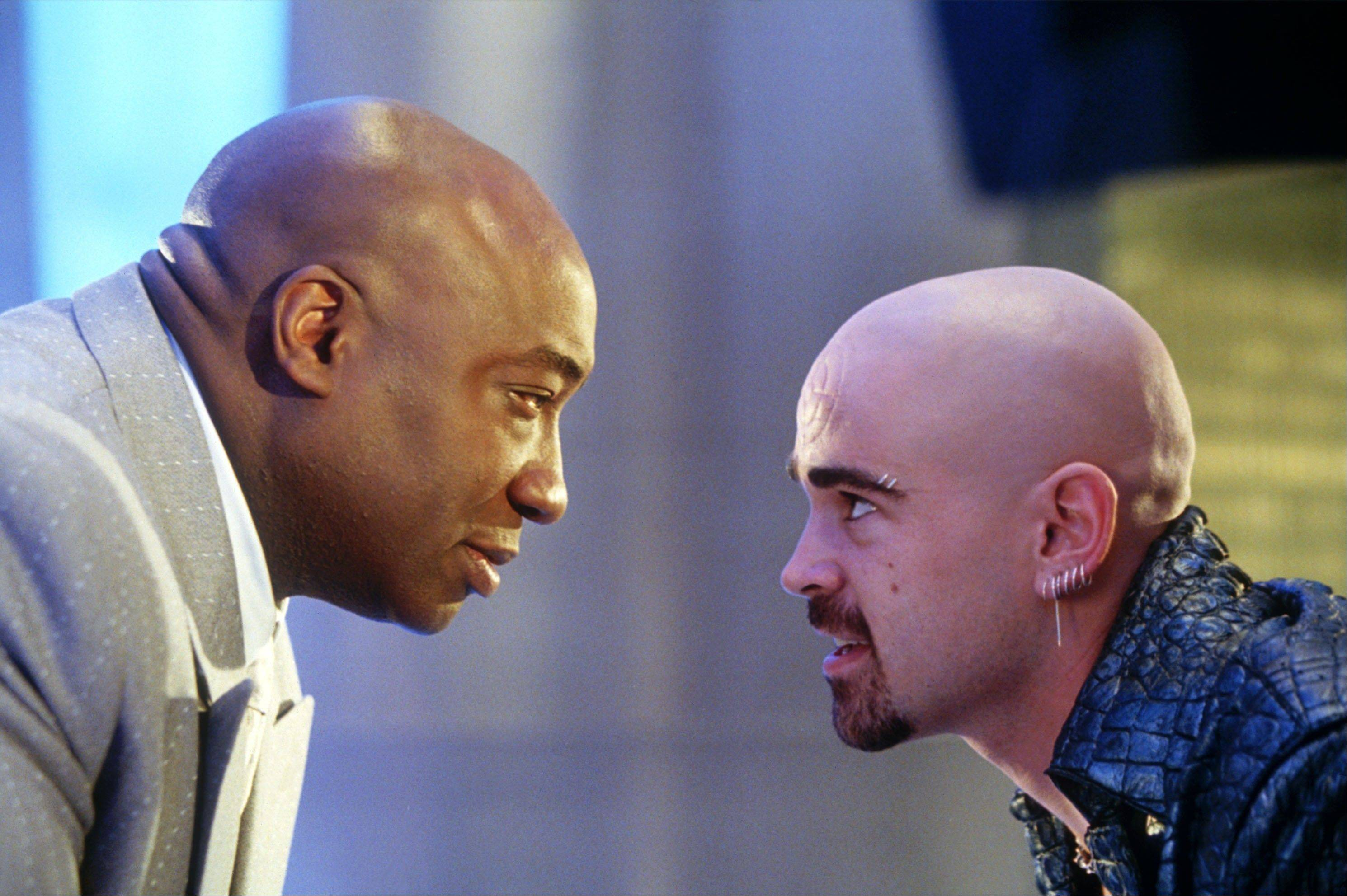 "In this undated movie still provided by Twentieth Century Fox, the crime lord Kingpin, played by Michael Clarke Duncan, left, hires Bullseye, played by Colin Farrell, in a scene from the movie ""Daredevil,"" based on a popular comic book published by Marvel. In Google's 12th annual roundup of global trending searches, ""Michael Clarke Duncan"" was ranked ninth."