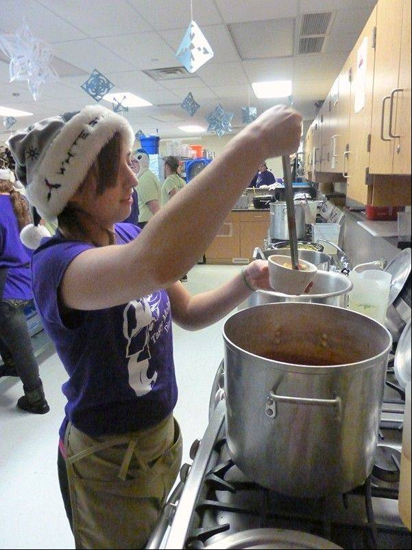 Senior Amanda Sigler serves turkey tortilla soup.