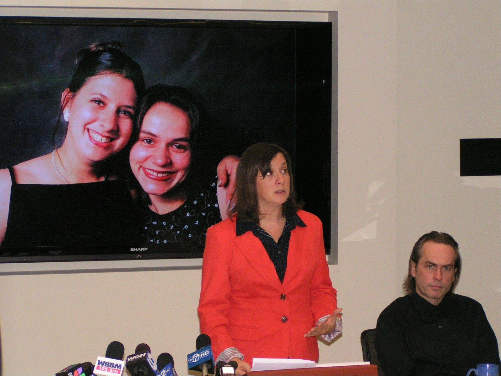Theresa O'Rourke of Downers Grove recalled memories of her longtime friend Jitka Vesel, who was murdered outside an Oak Brook office complex last year. O'Rourke and Vesel's brother, Alex Vesely, seated, spoke out Wednesday against a website used by Vesel's ex-boyfriend to find the gun he used to kill her.