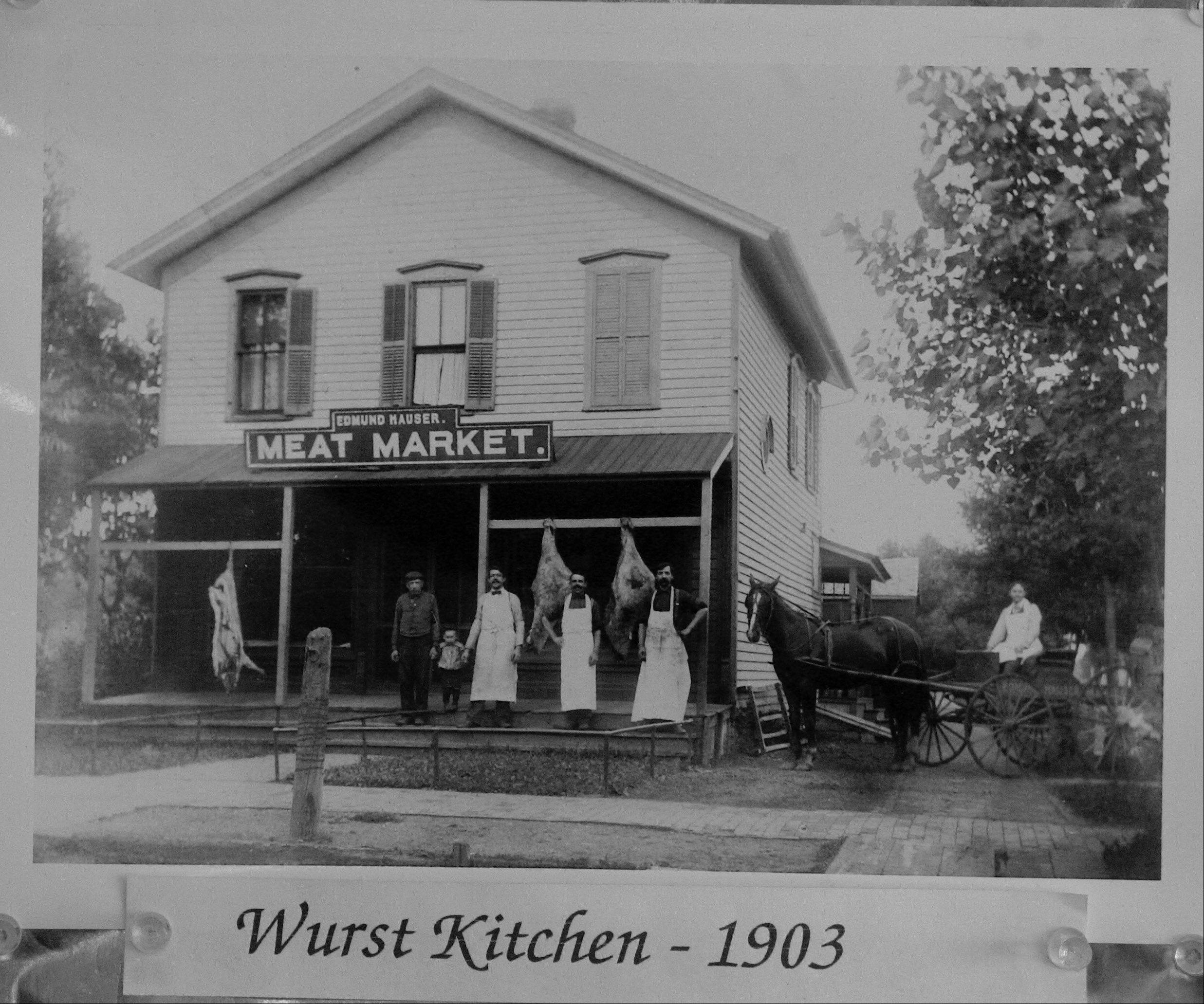 A photo hanging in Wurst Kitchen shows what the store looked like in 1903 when it was known as Hauser Meat Market.