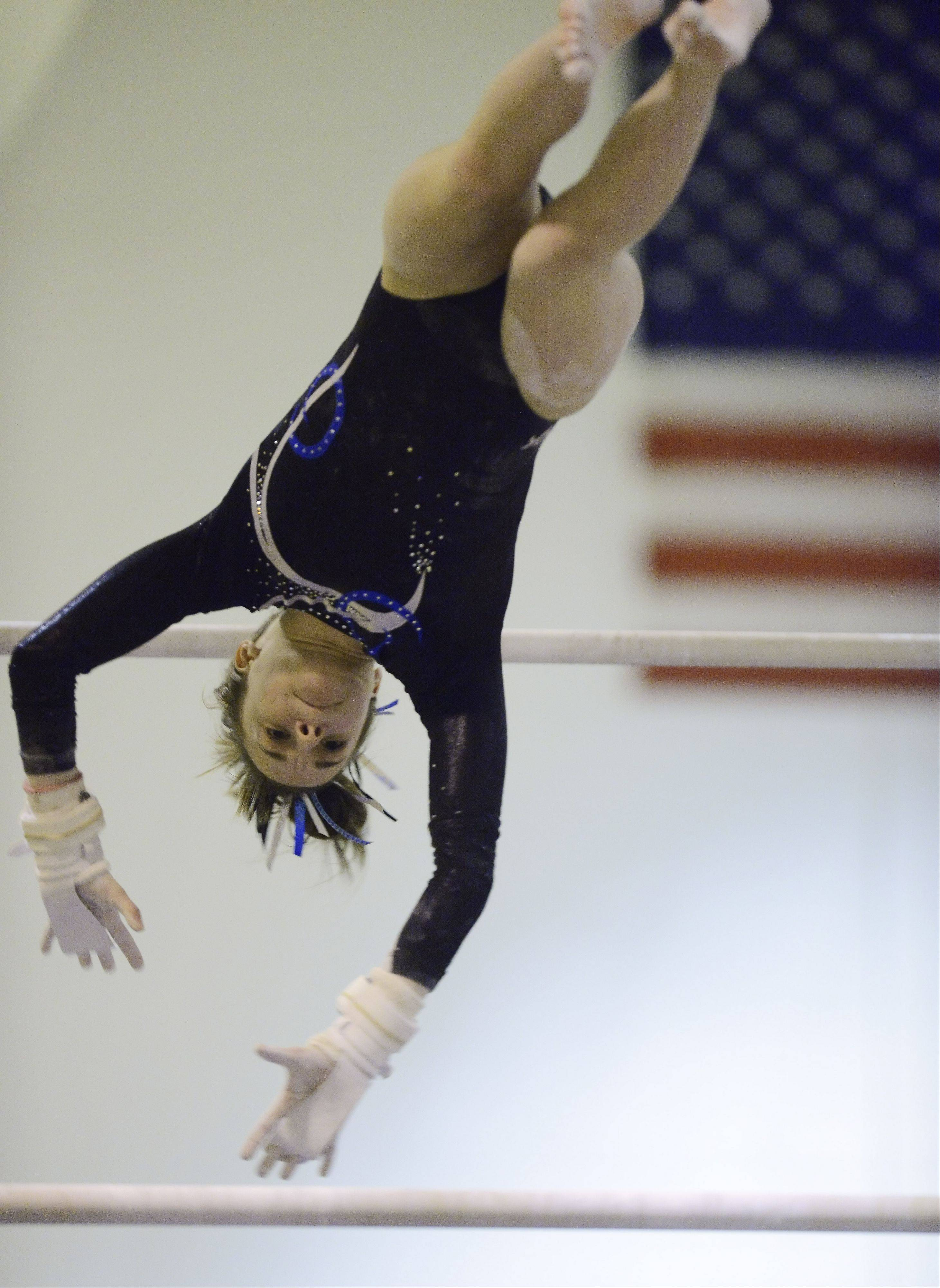 Prospect's Maddie Larock competes on the uneven parallel bars during Wednesday's gymnastics meet with Hersey and Wheeling.