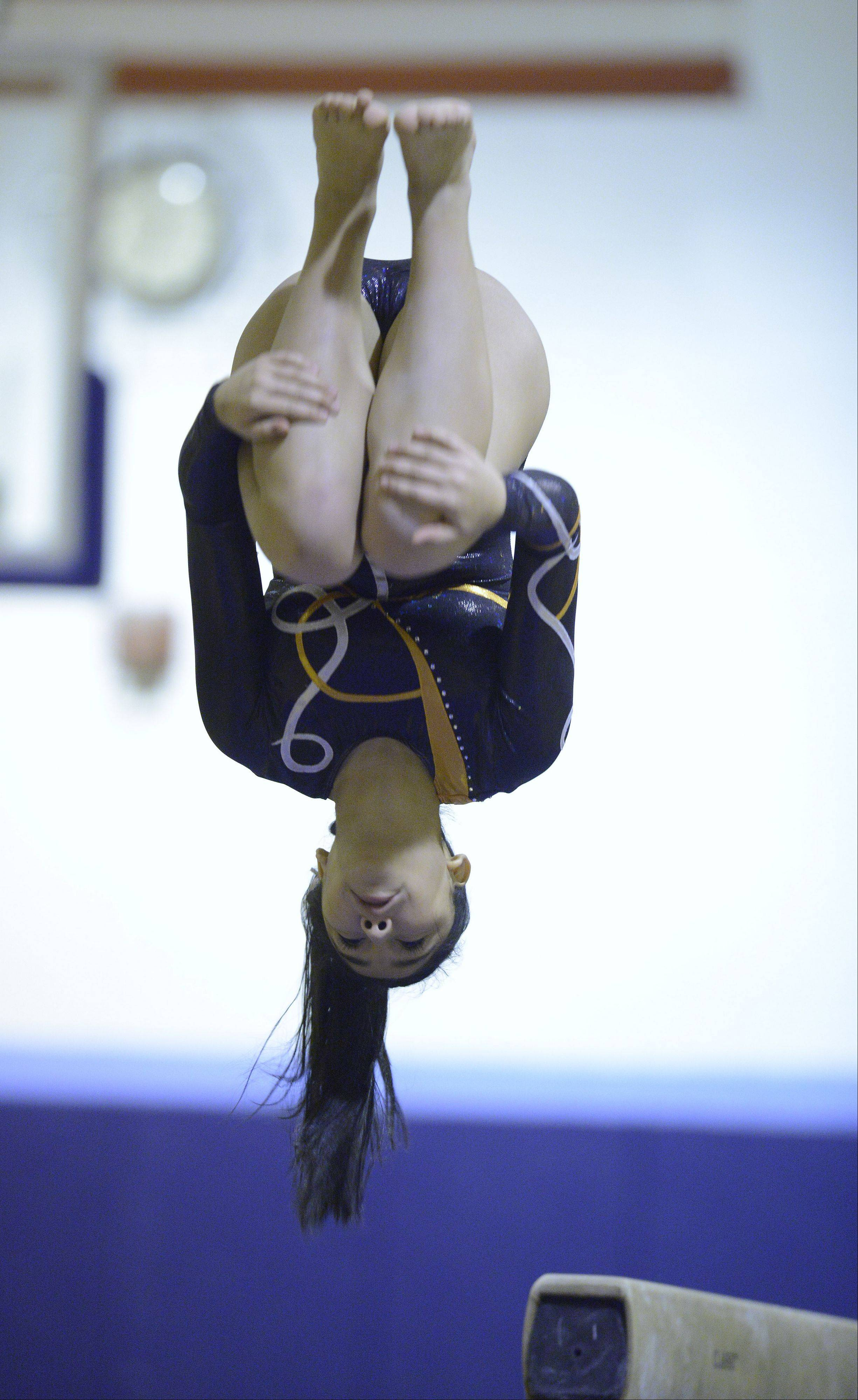 Hersey's Andrea Banda dismounts from the balance beam during Wednesday's gymnastics meet at Prospect.