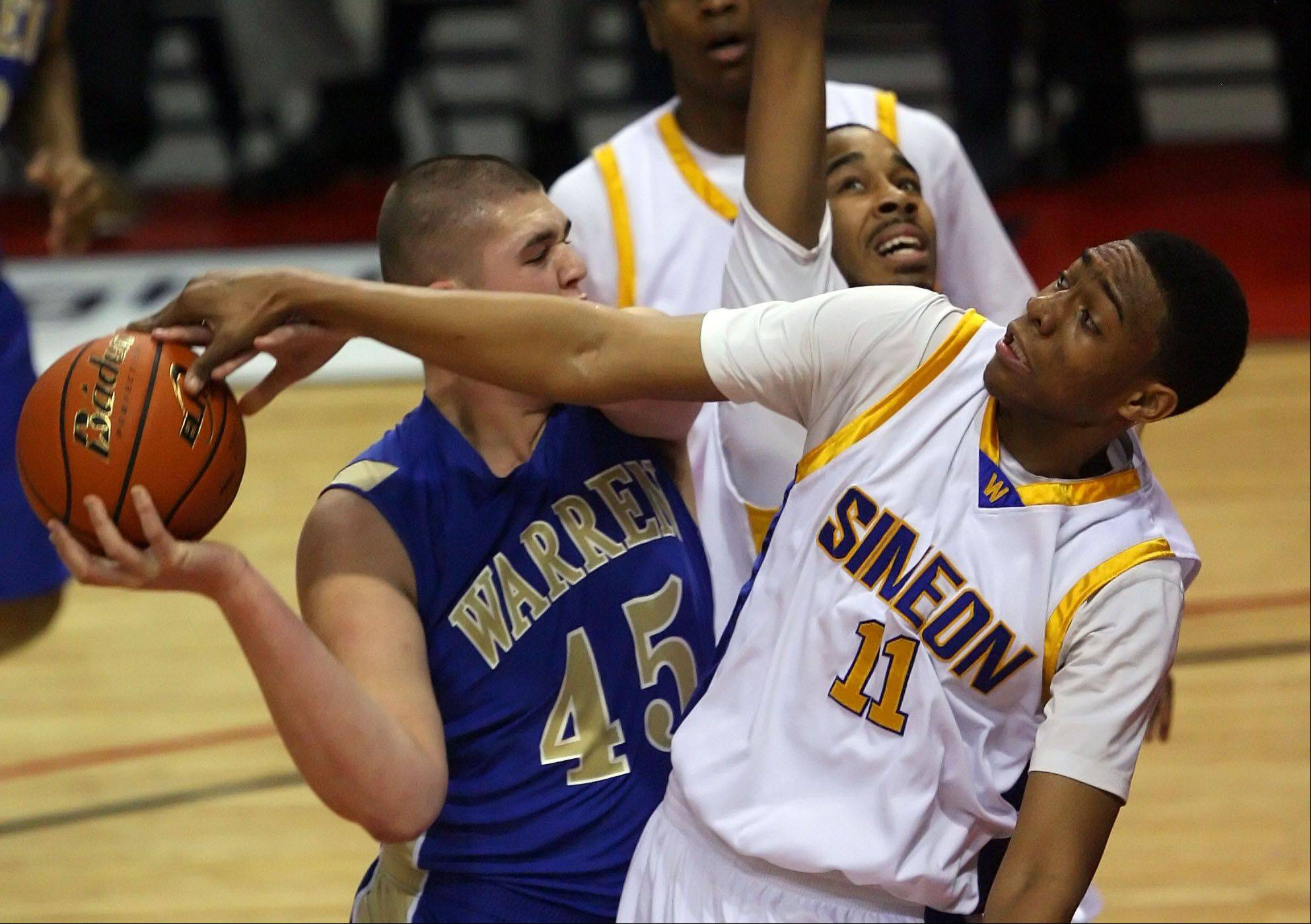 Simeon's Jabari Parker, here trying to stop Warren's Nathan Boothe in the 2012 IHSA Class 4A state championship game, is expected to declare his college choice on Dec. 20.