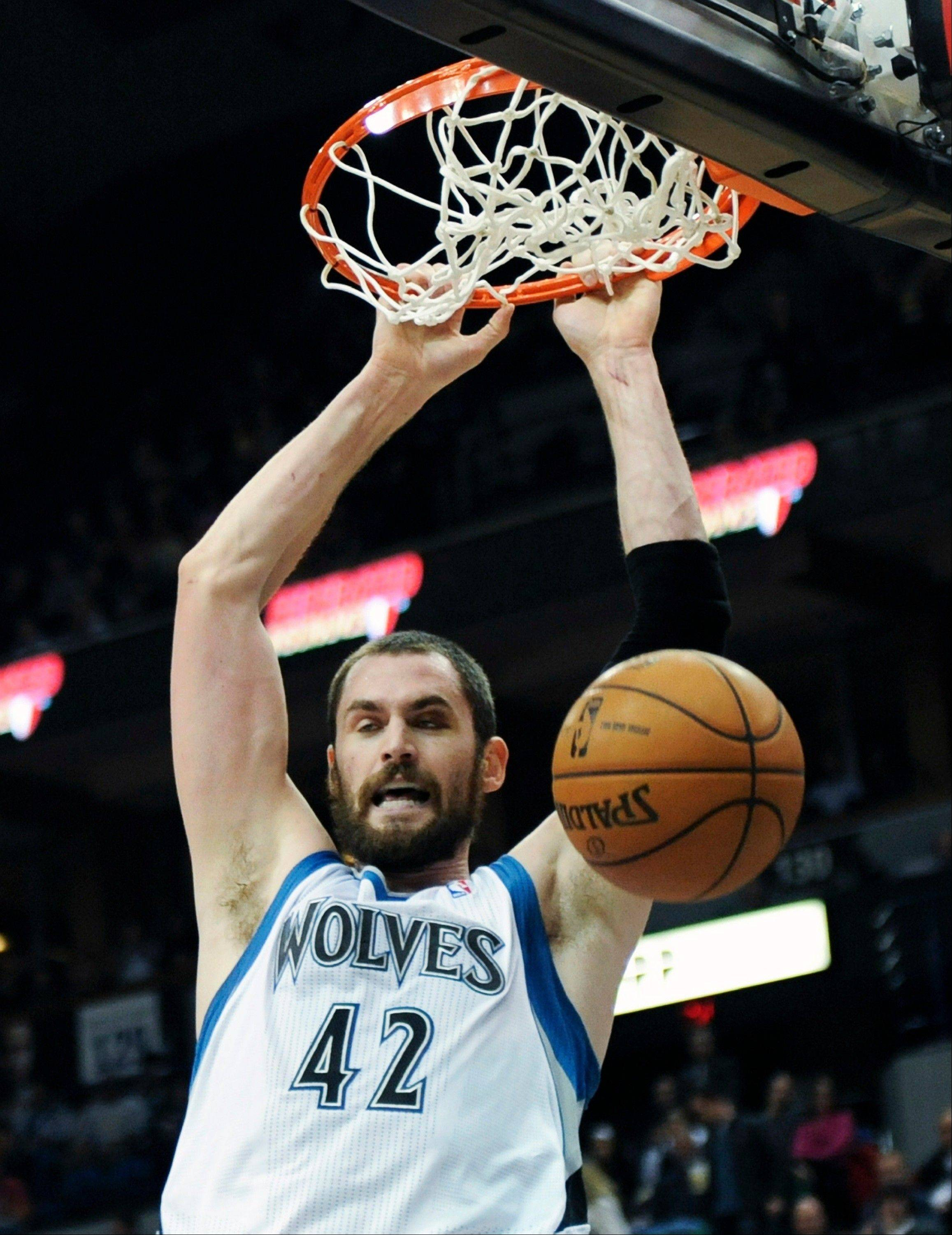 Minnesota Timberwolves forward Kevin Love dunks Friday against the Cleveland Cavaliers in Minneapolis. Love met with the media on Wednesday morning before the Wolves were scheduled to host the Denver Nuggets to address comments he made to Yahoo! Sports that were critical of Timberwolves leadership.